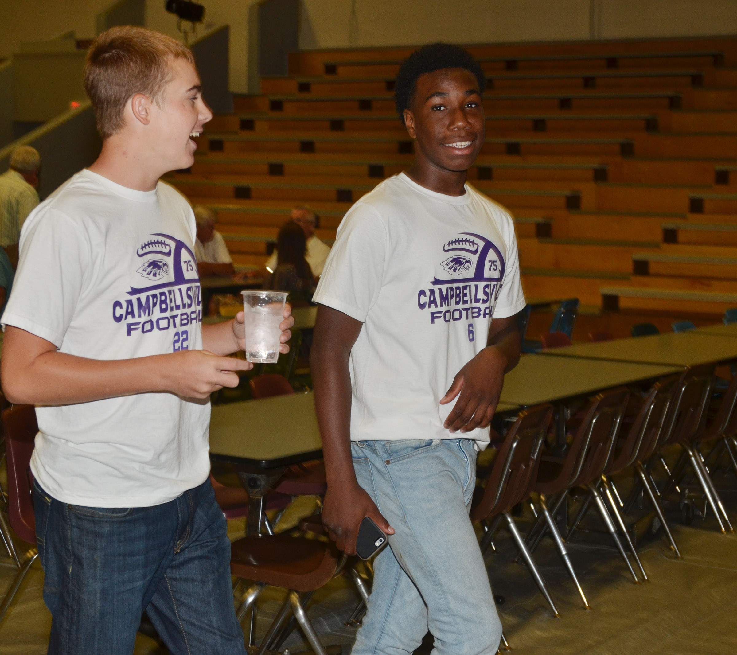CHS sophomores Tyler Gribbins, at left, and Malachi Corley share a laugh at the annual CHS football dinner and auction.