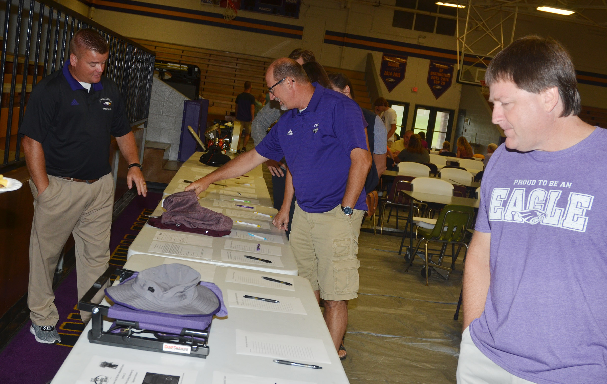CHS head football coach Dale Estes mans the silent auction.
