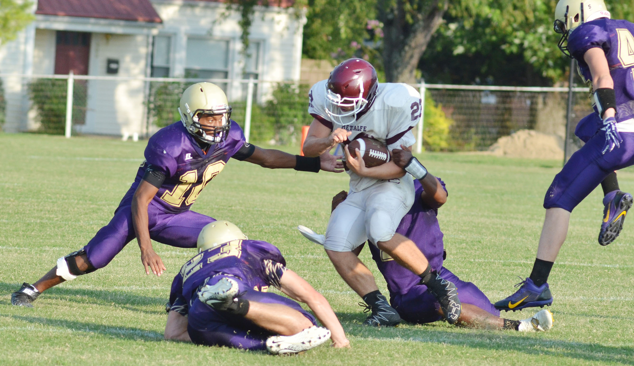 CHS senior Devonte Cubit, at left, and his teammates tackle.