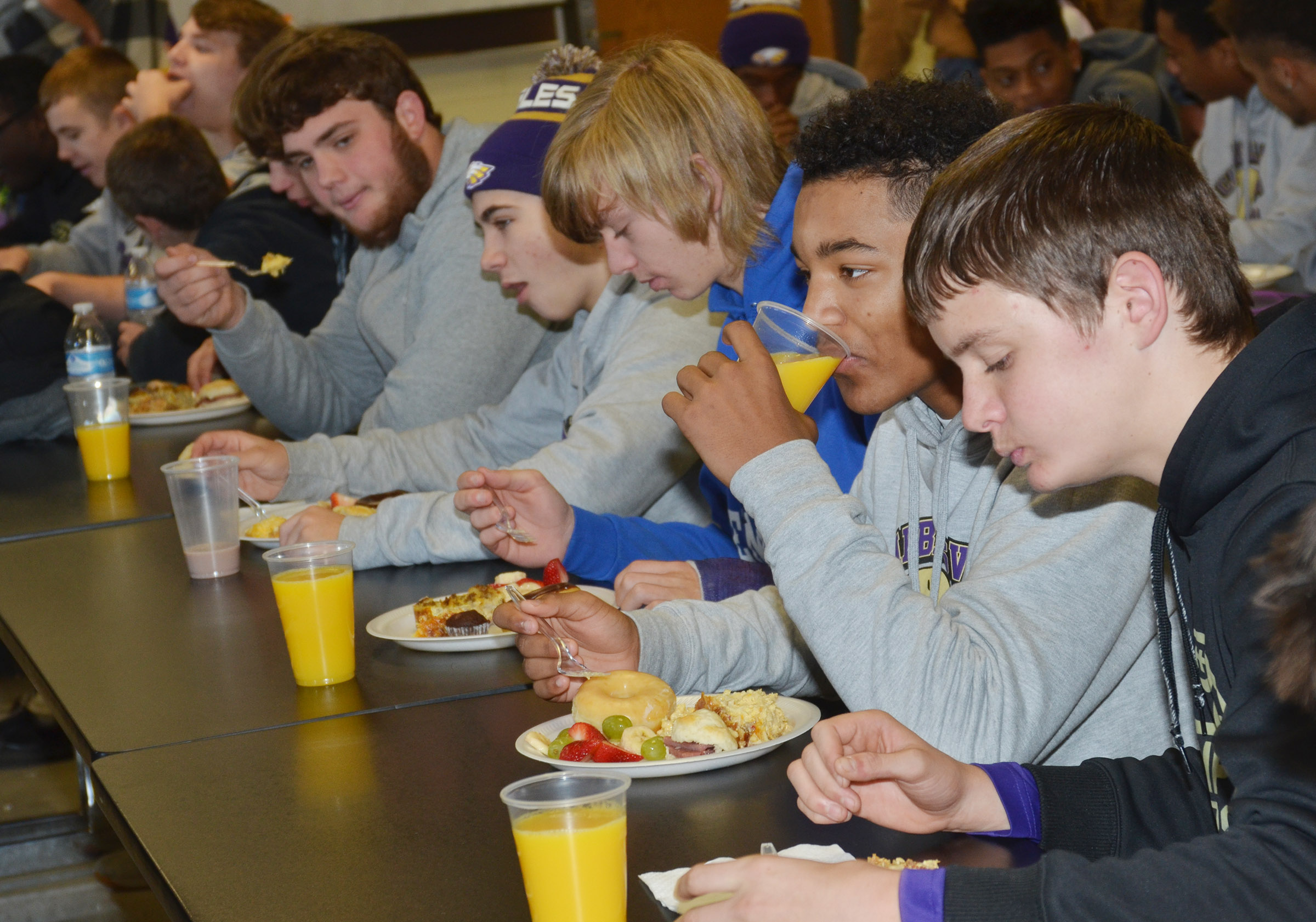 CHS football players enjoy a special breakfast.
