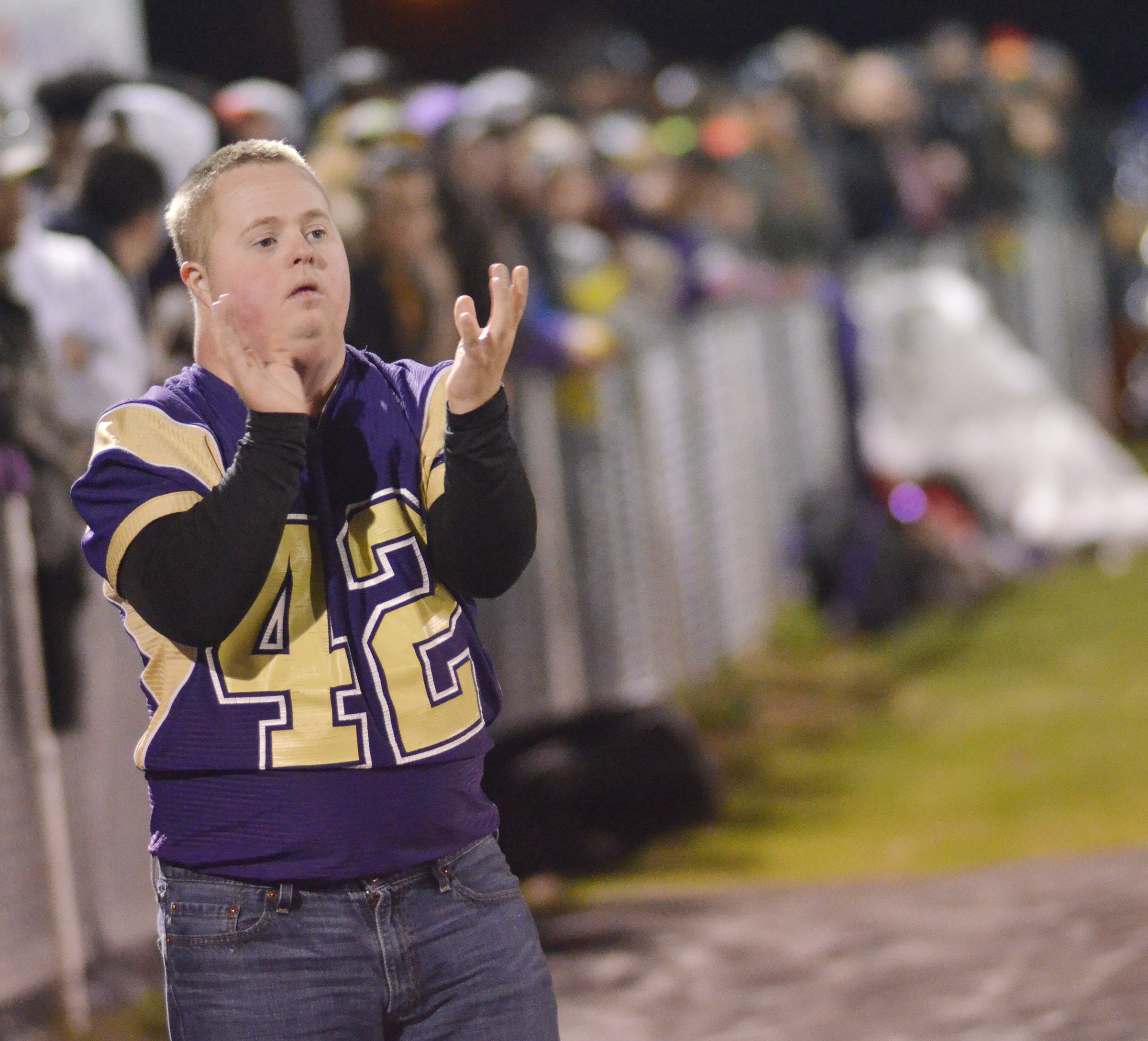 Eagle fan Brennan Wheatley cheers for his team.