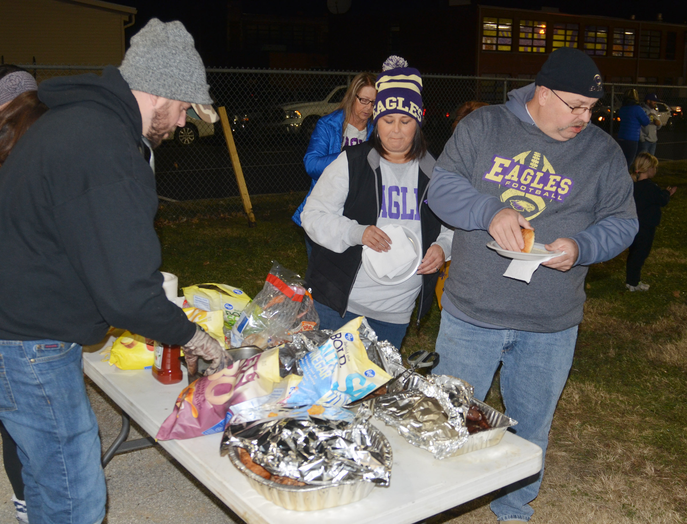 CHS hosted a tailgate before the game for students, staff members and fans. Board of Education member Suzanne Wilson and her husband Daren get their food.