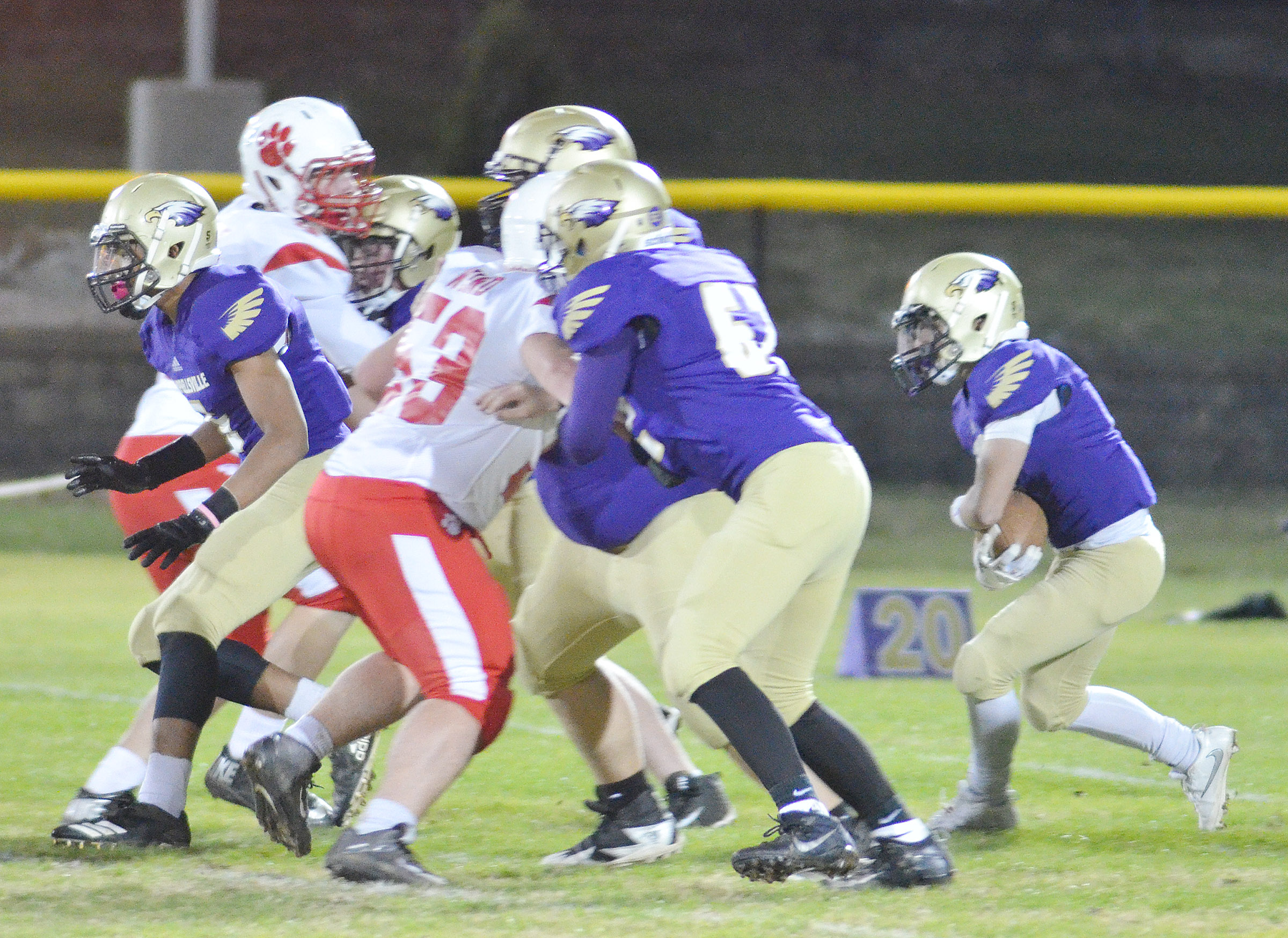 CHS senior Austin Carter runs the ball as his teammates block for him.
