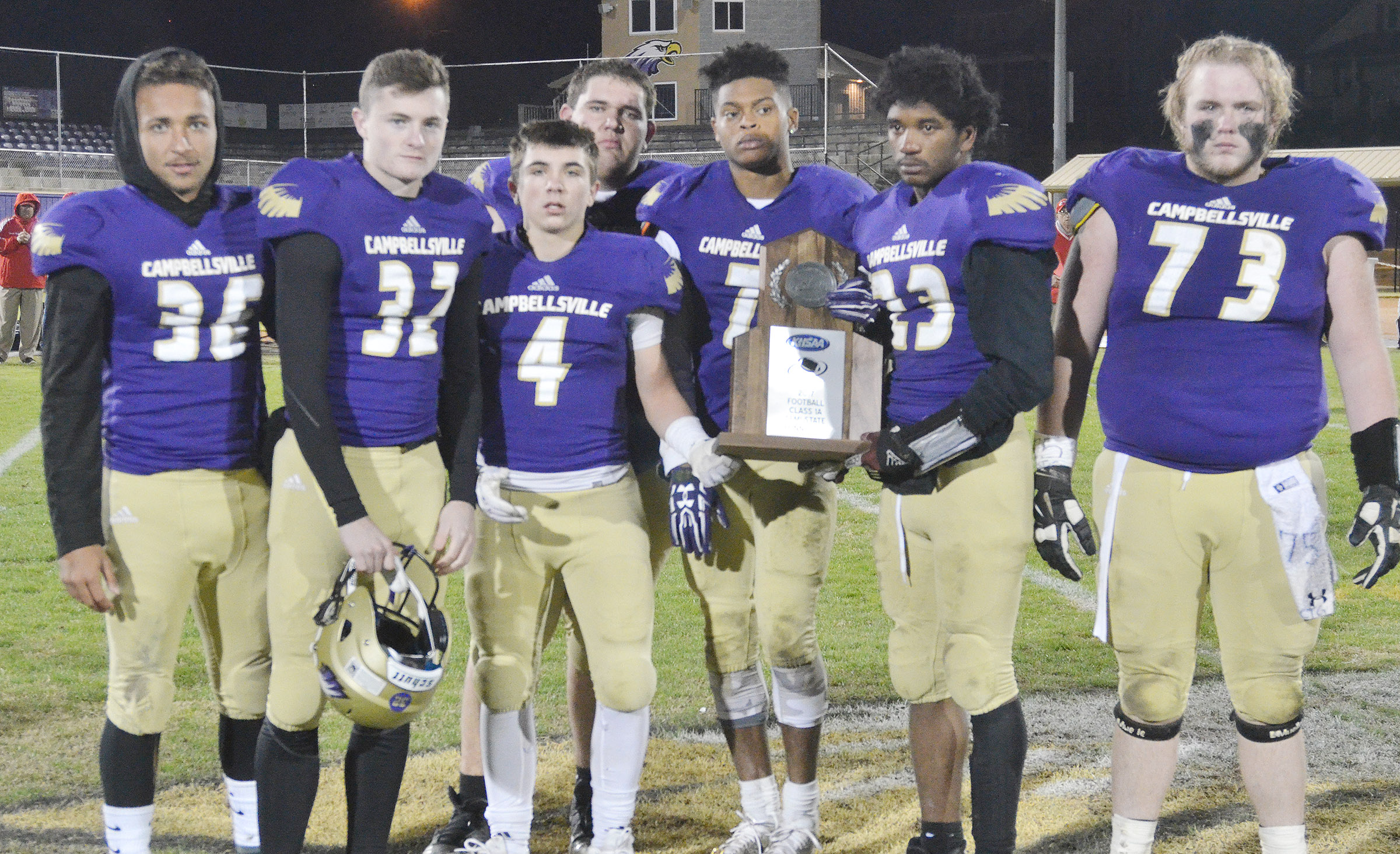 CHS football seniors, from left, Ethan Lay, Bryce Richardson, Austin Carter, Ryan Wiedewitsch, Devonte Cubit, Tyrion Taylor and Ryan Jeffries receive their semi-finals runner-up trophy.