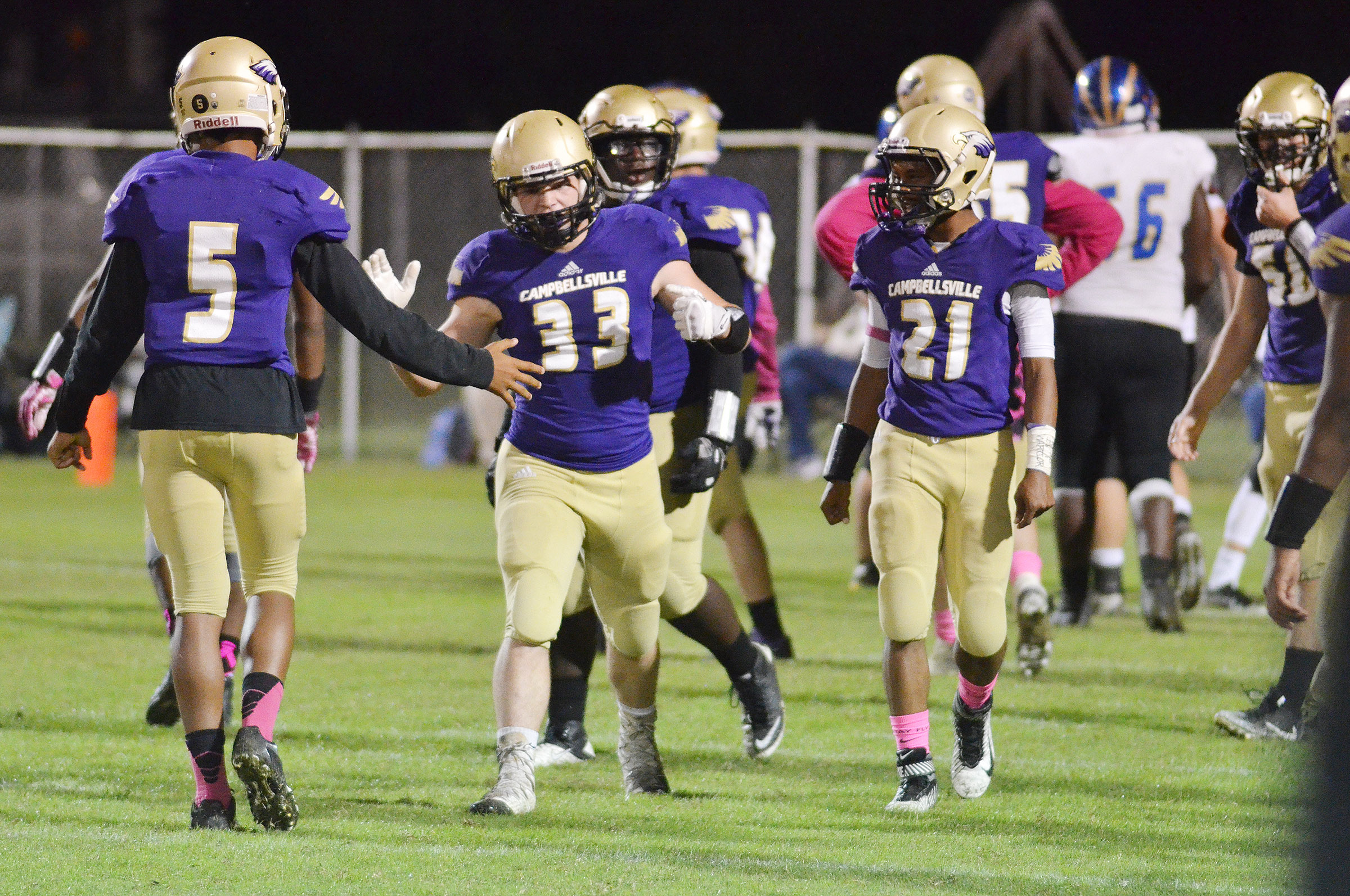 CHS football players celebrate a play.