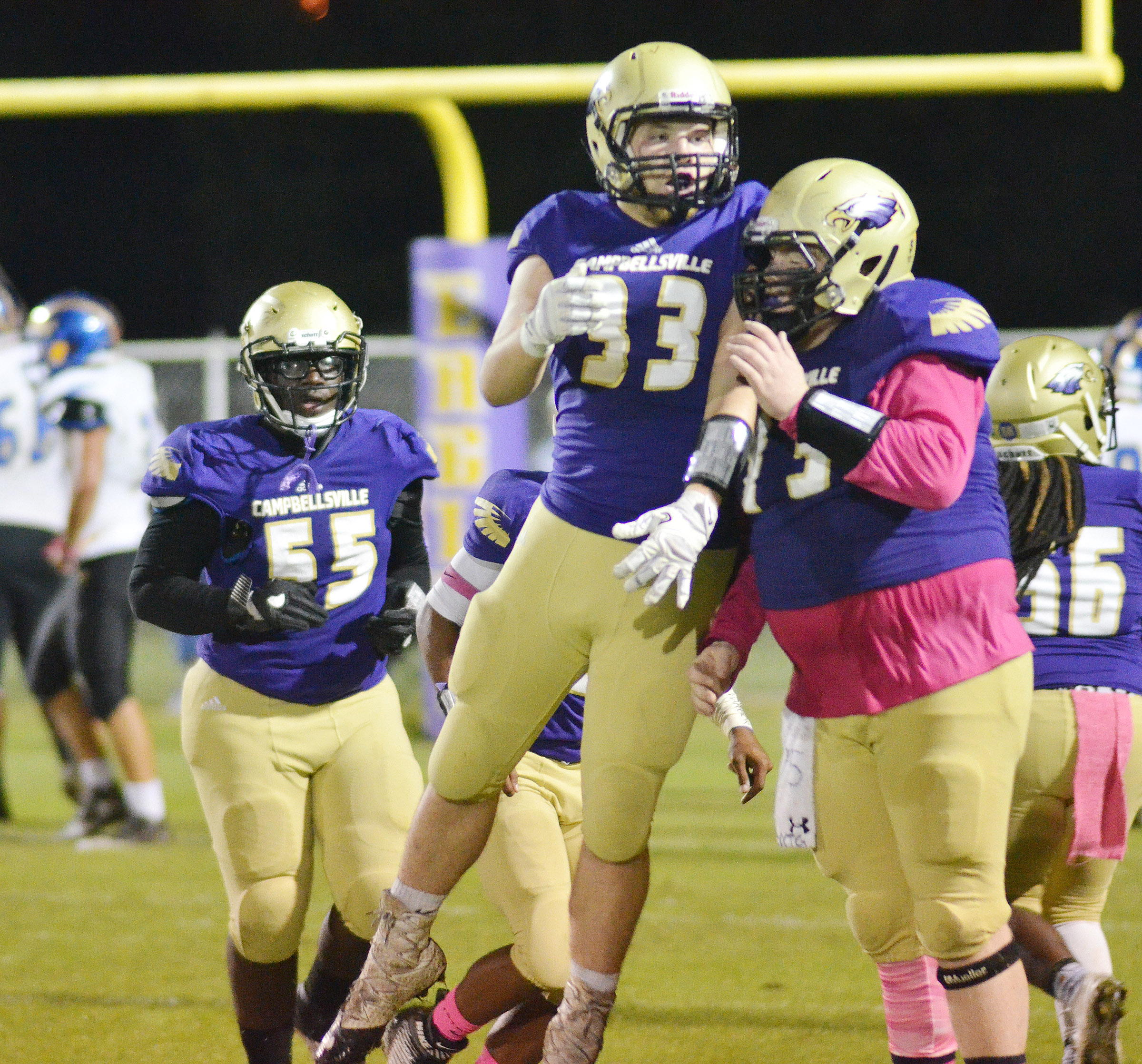 CHS junior Dakota Reardon, center, and senior Ryan Jeffries celebrate a touchdown.