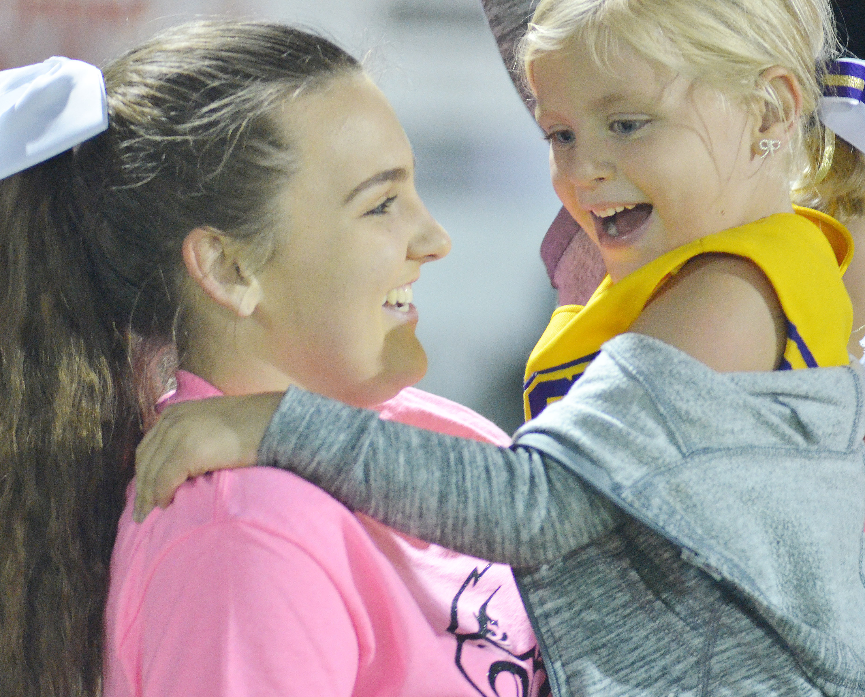 CHS sophomore Haley Morris cheers with Campbellsville Elementary School kindergartener Remi Petett.