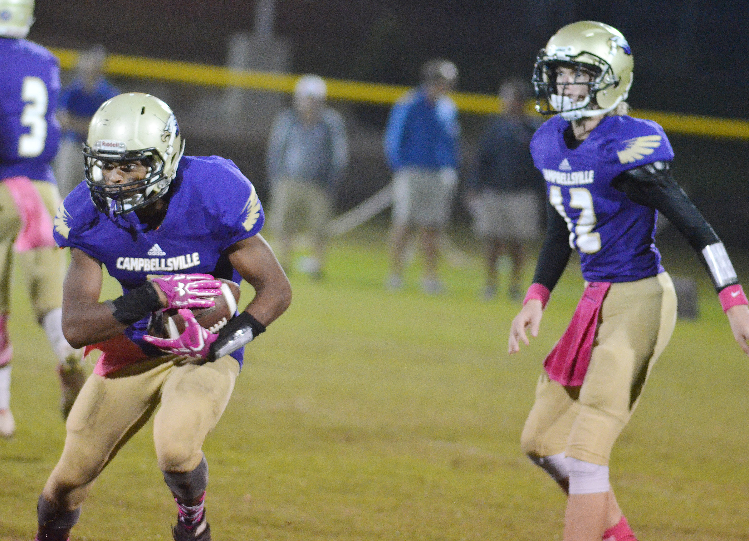 CHS senior Devonte Cubit runs the ball, after getting the pass from freshman Arren Hash.