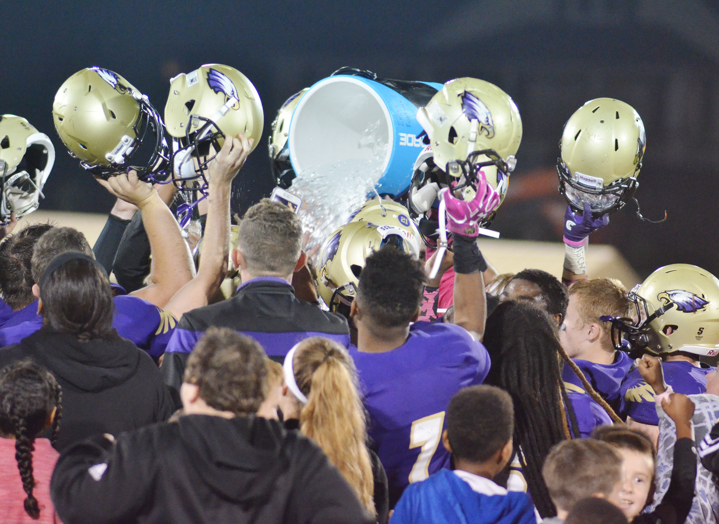 CHS football players celebrate their victory.