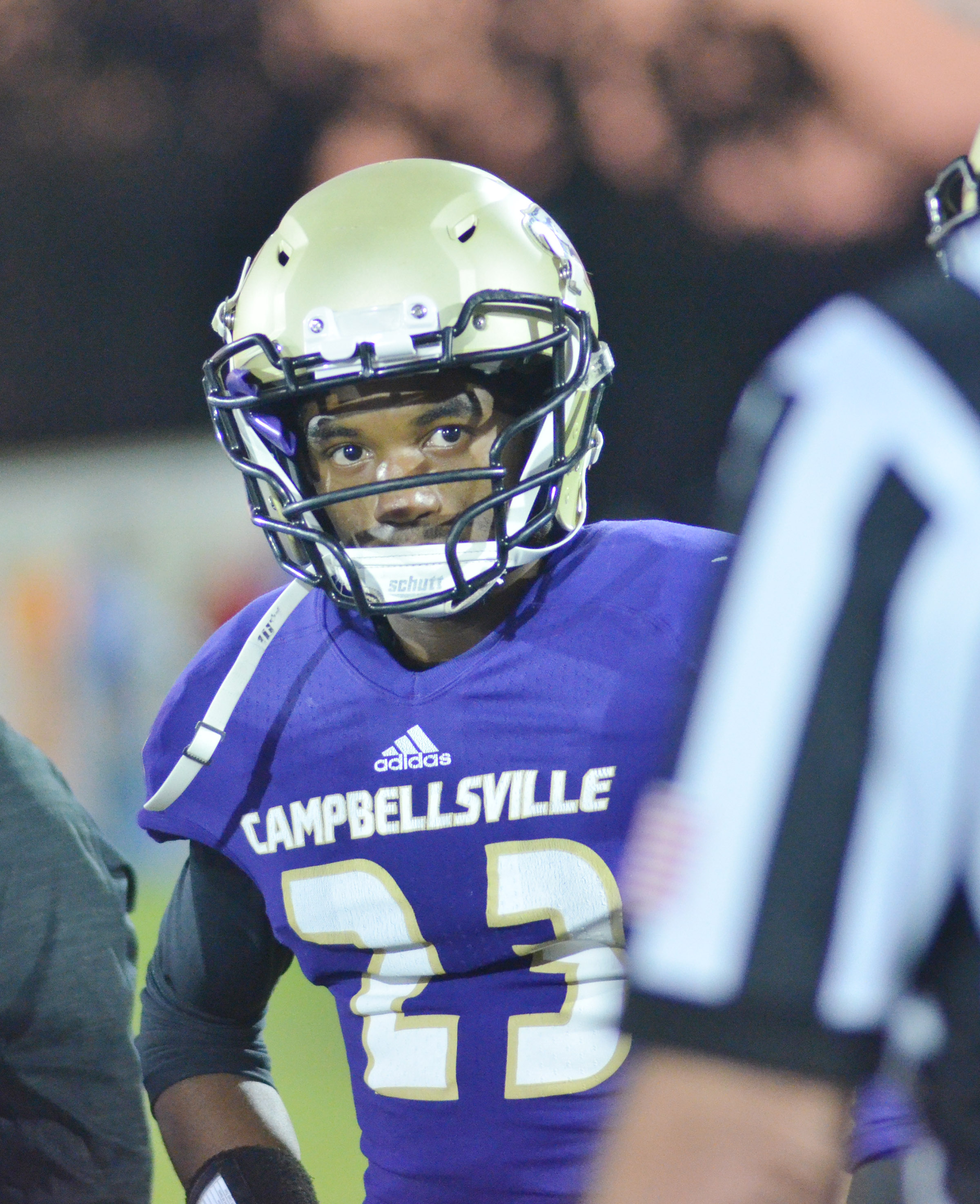 CHS senior Tyrion Taylor listens to an official during the coin toss.