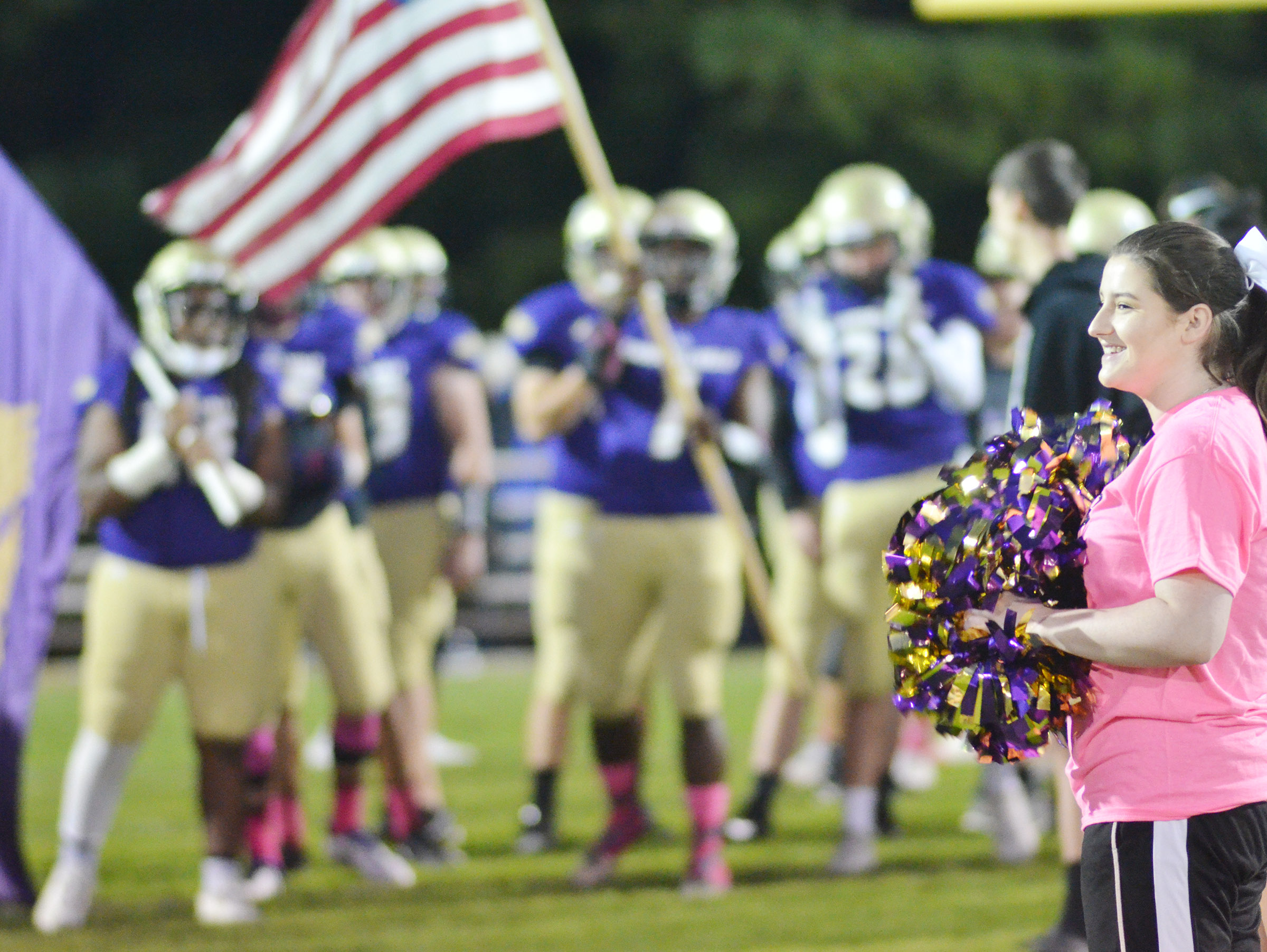 CHS sophomore Alli Wilson cheers as football players prepare to take the field.