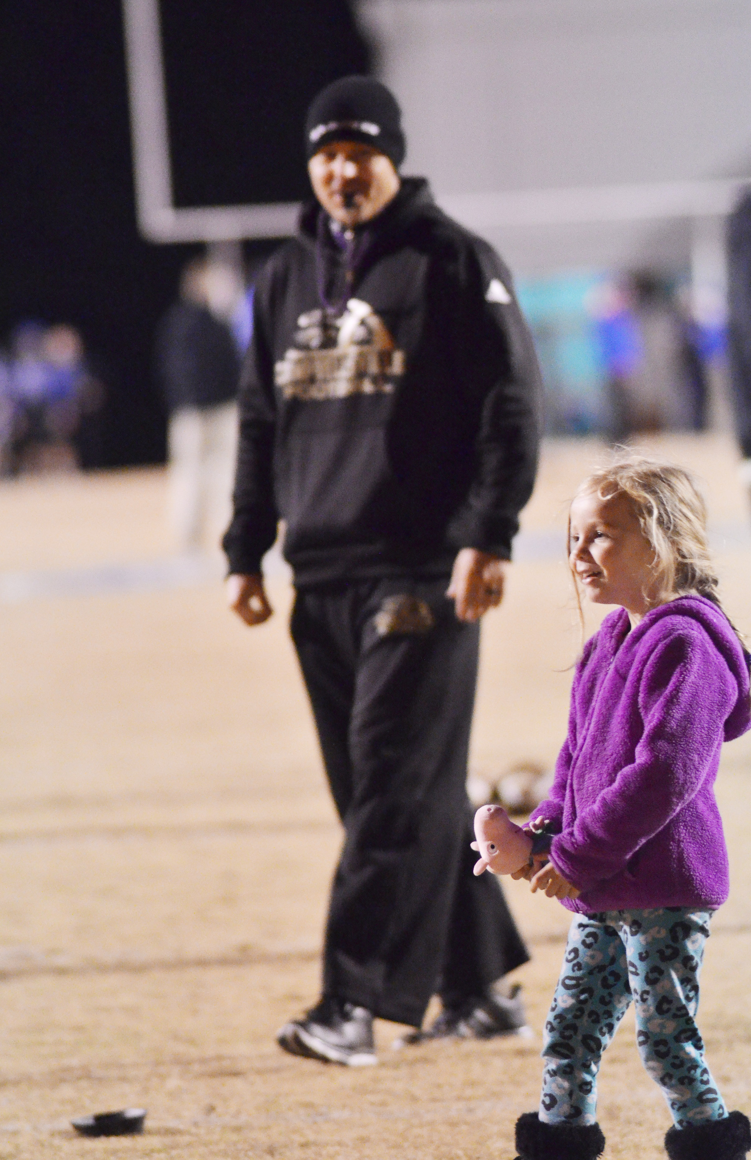Campbellsville Elementary School kindergartener Trinidy Gribbins watches as her dad, Robbie, coaches the CHS football team.