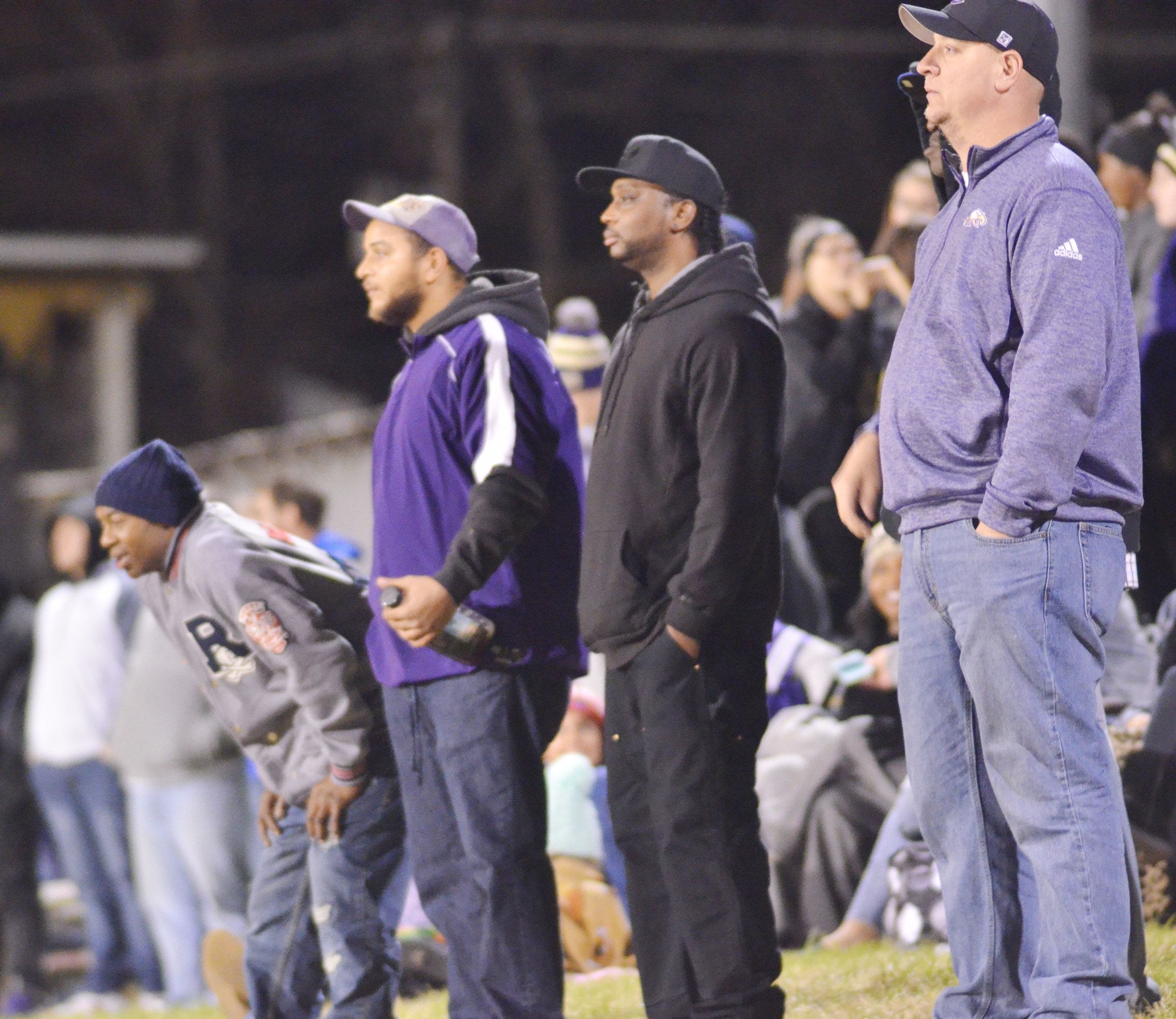 CHS Principal David Petett, at right, and Eagle fans watch the game.