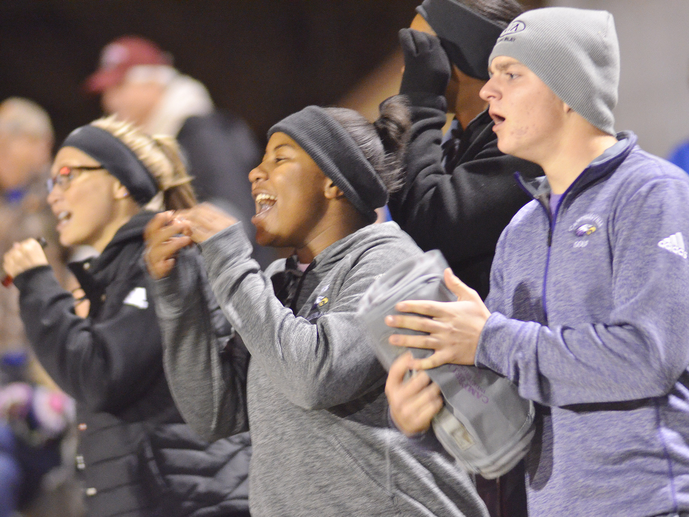 CHS students, from left, juniors Tatem Wiseman and Kiyah Barnett and senior Alex Doss cheer for the Eagles.