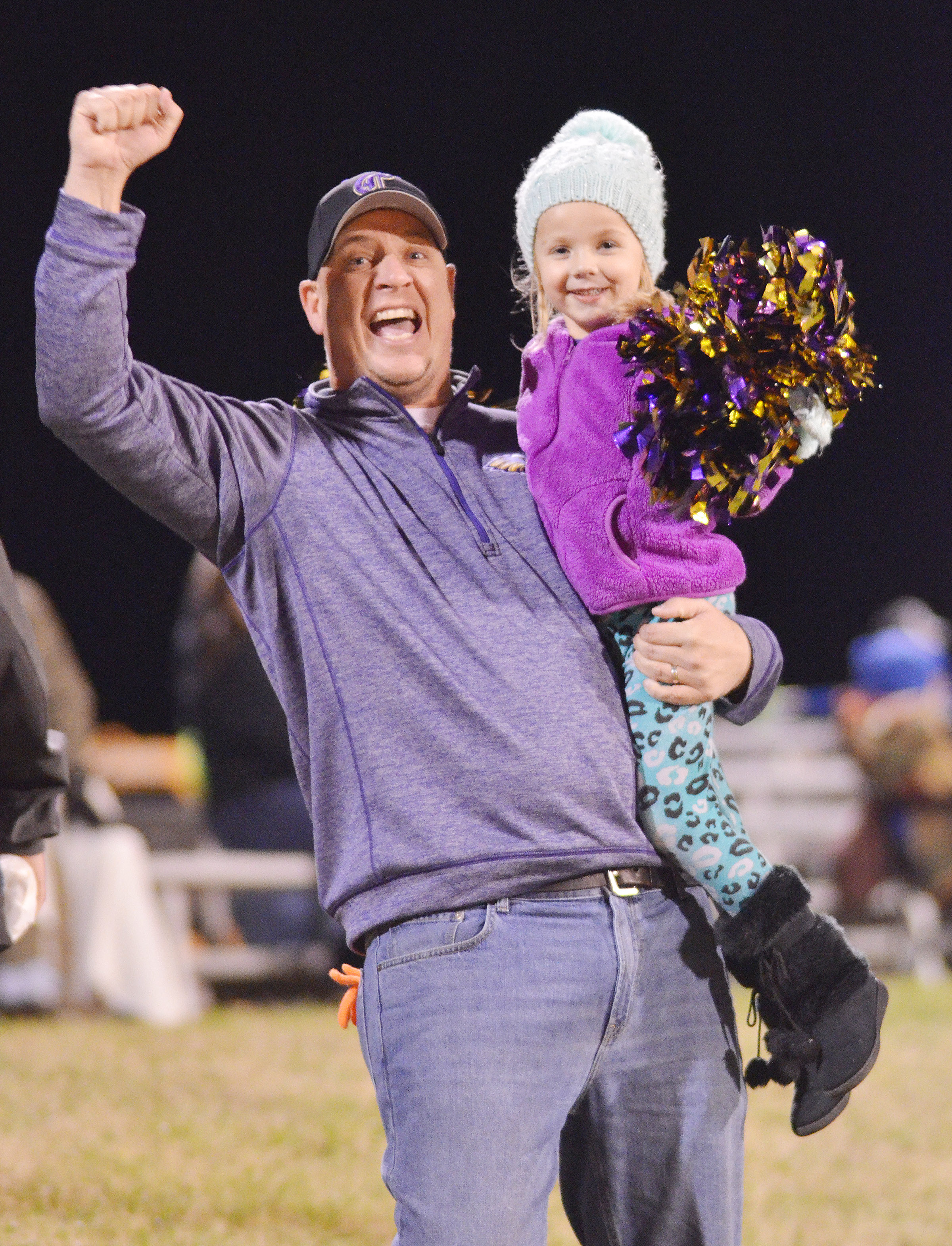 CHS Principal David Petett and Campbellsville Elementary School kindergartener Trinidy Gribbins cheer for the Eagles.
