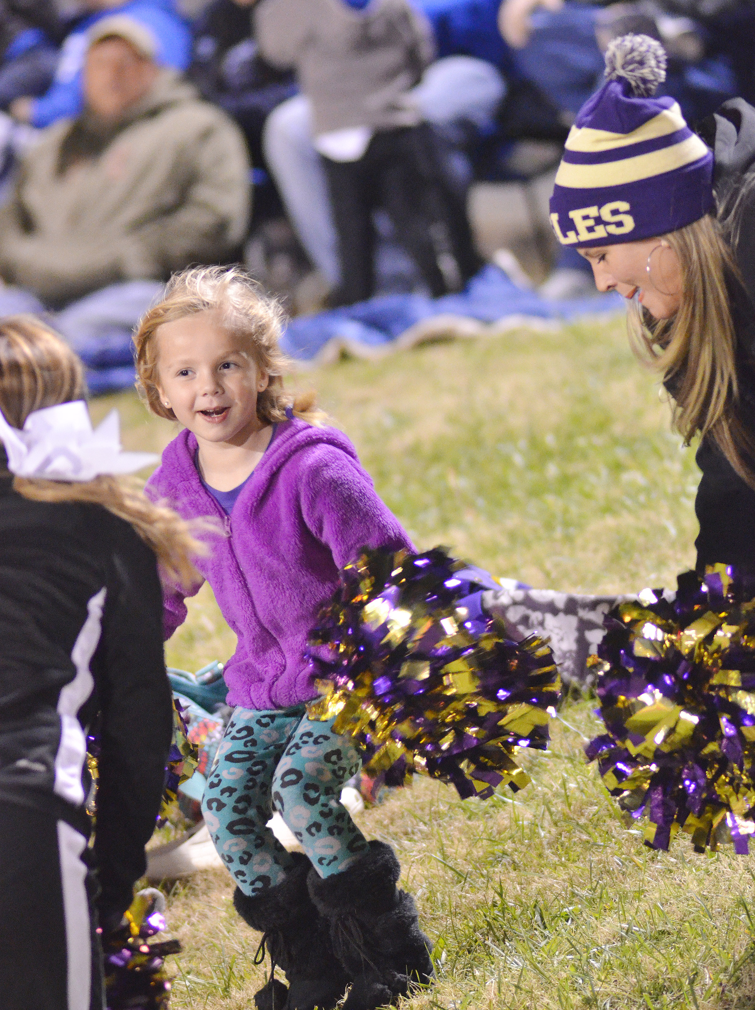 Campbellsville Elementary School kindergartener Trinidy Gribbins and her mother, Andrea, a teacher at Campbellsville Middle School, cheer with the CHS cheerleaders.