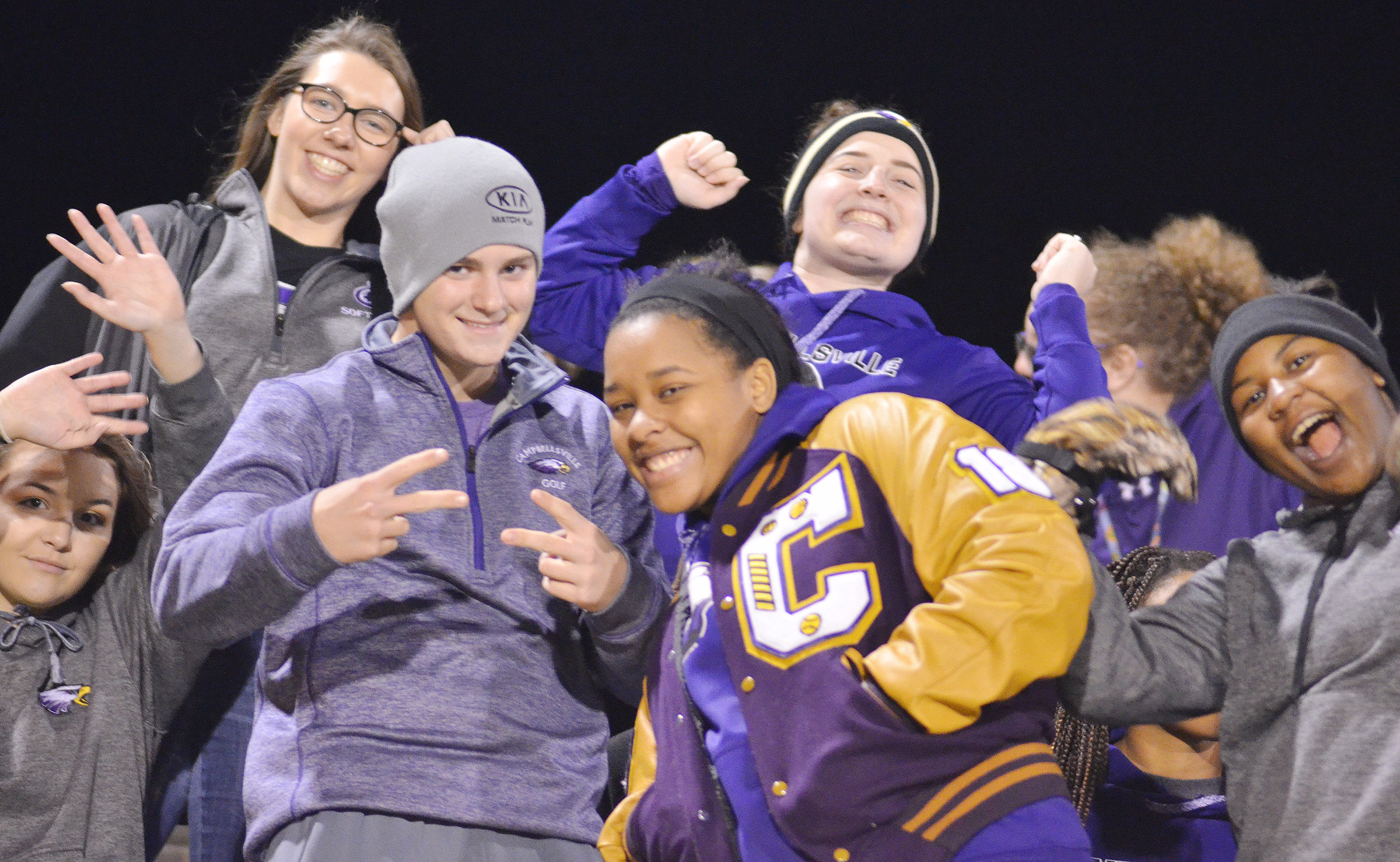 CHS students, from left, freshmen Kenzi Forbis and Abi Wiedewitsch, seniors Alex Doss, Kayla Young and Caitlin Bright and junior Kiyah Barnett cheer for the Eagles.