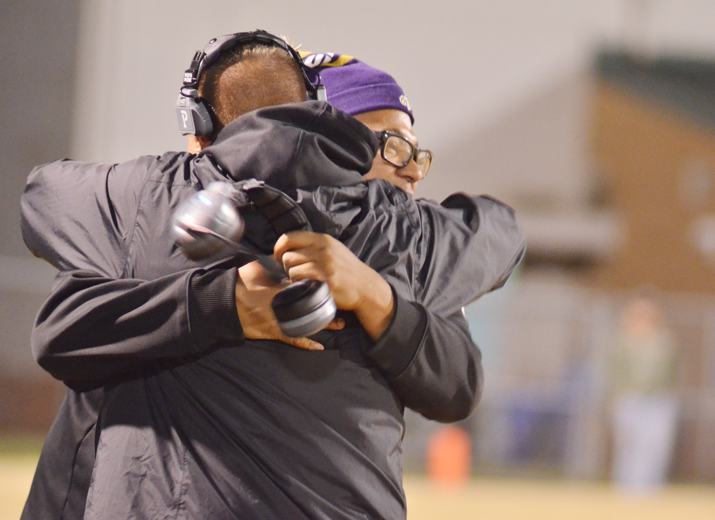 CHS head football coach Dale Estes hugs assistant coach Bronson Gowdy as the Eagles win.