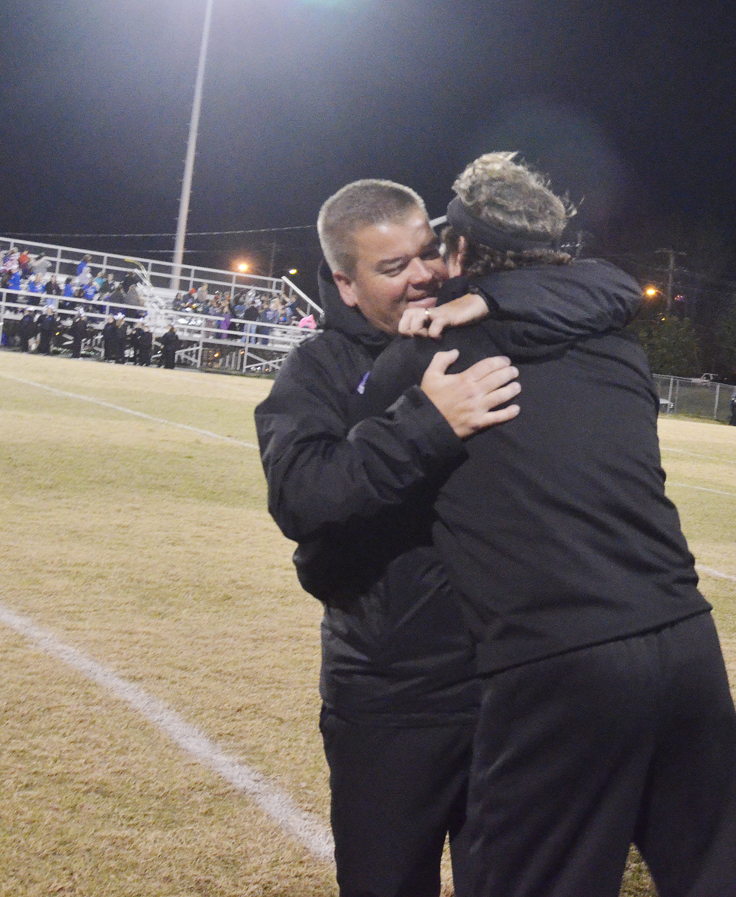 CHS head football coach Dale Estes hugs assistant coach Herb Wiseman.