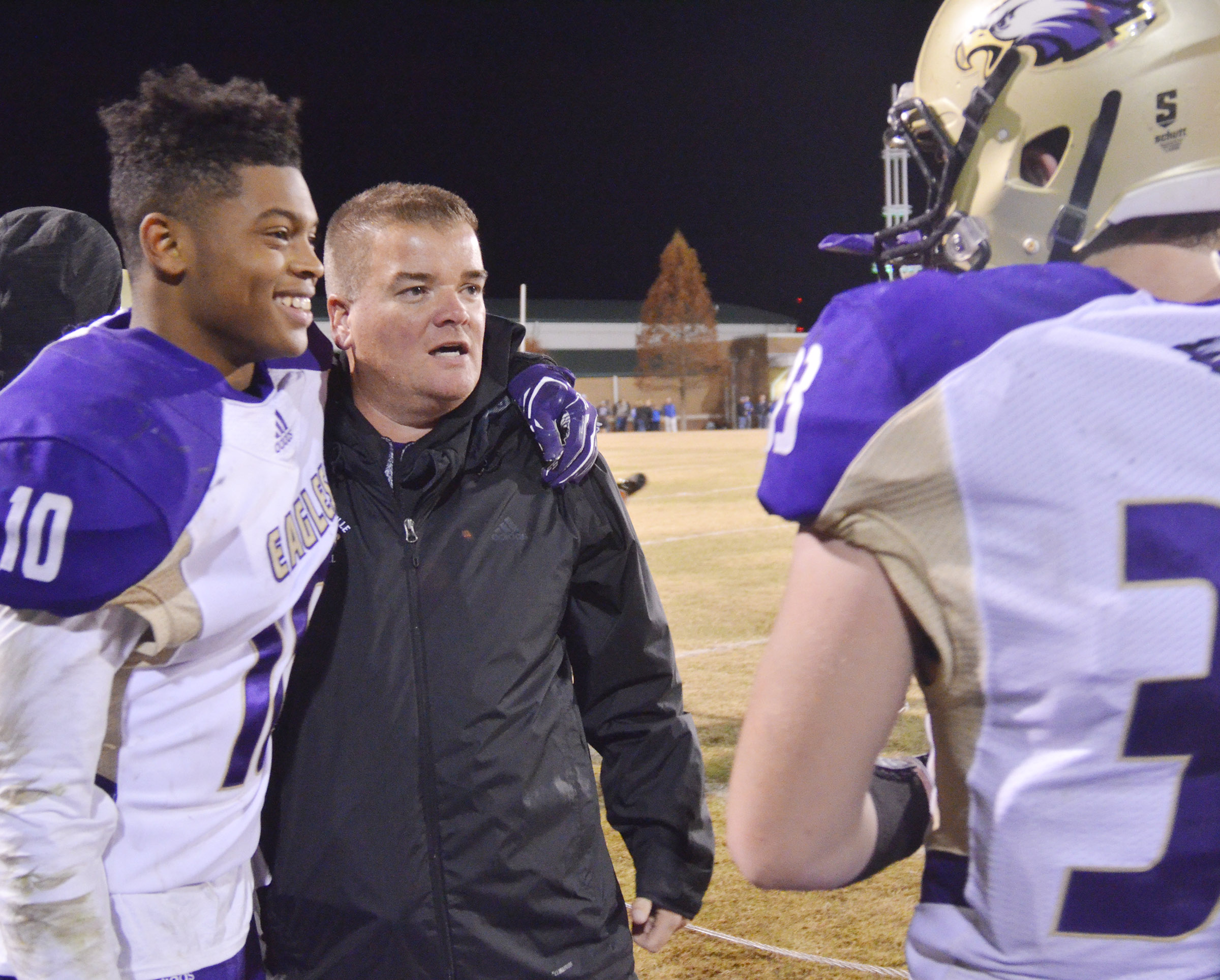 CHS head football coach Dale Estes celebrates with senior Devonte Cubit.
