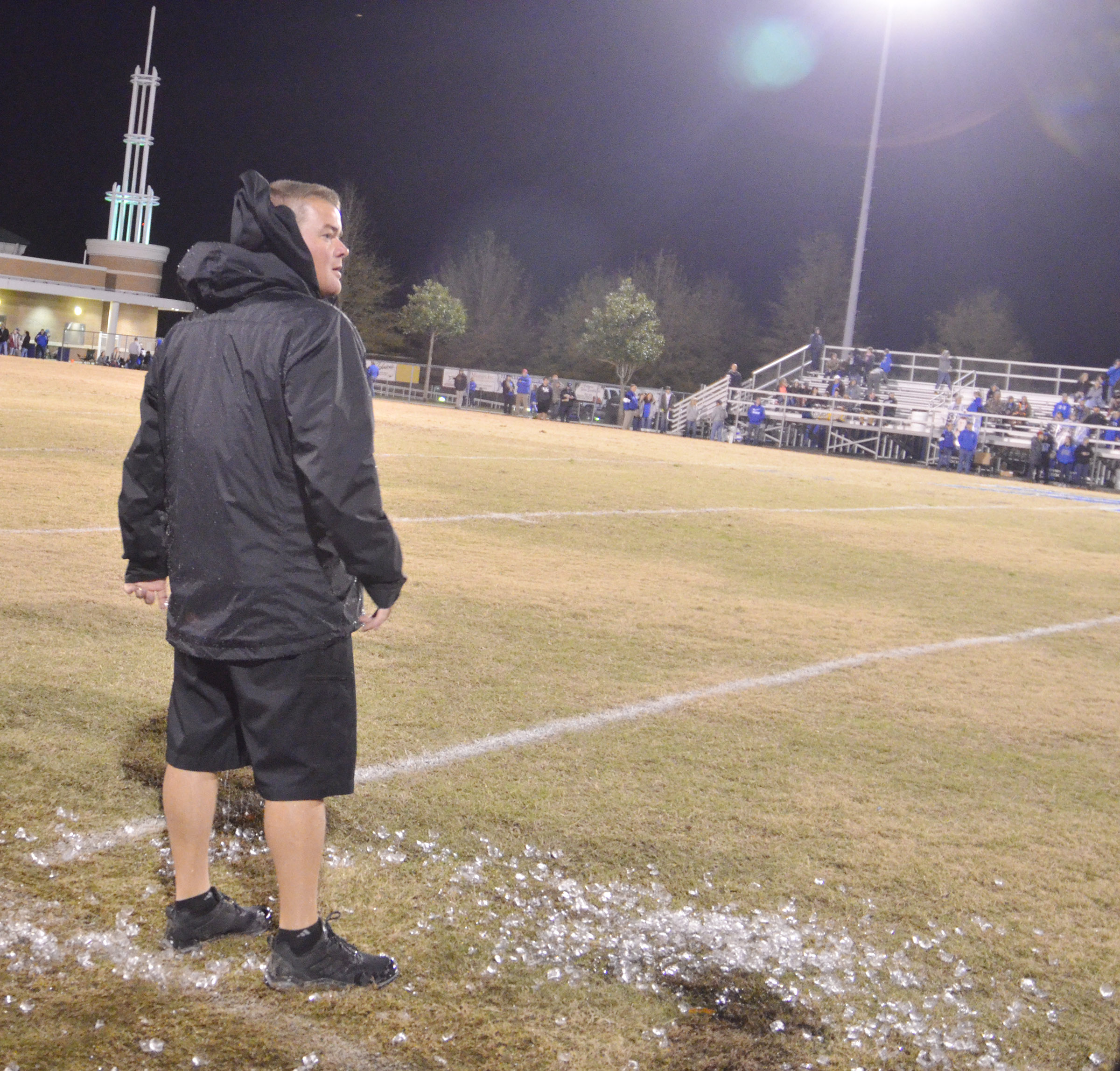 CHS head football coach Dale Estes watches as the clock winds down after his players soaked him with ice water.