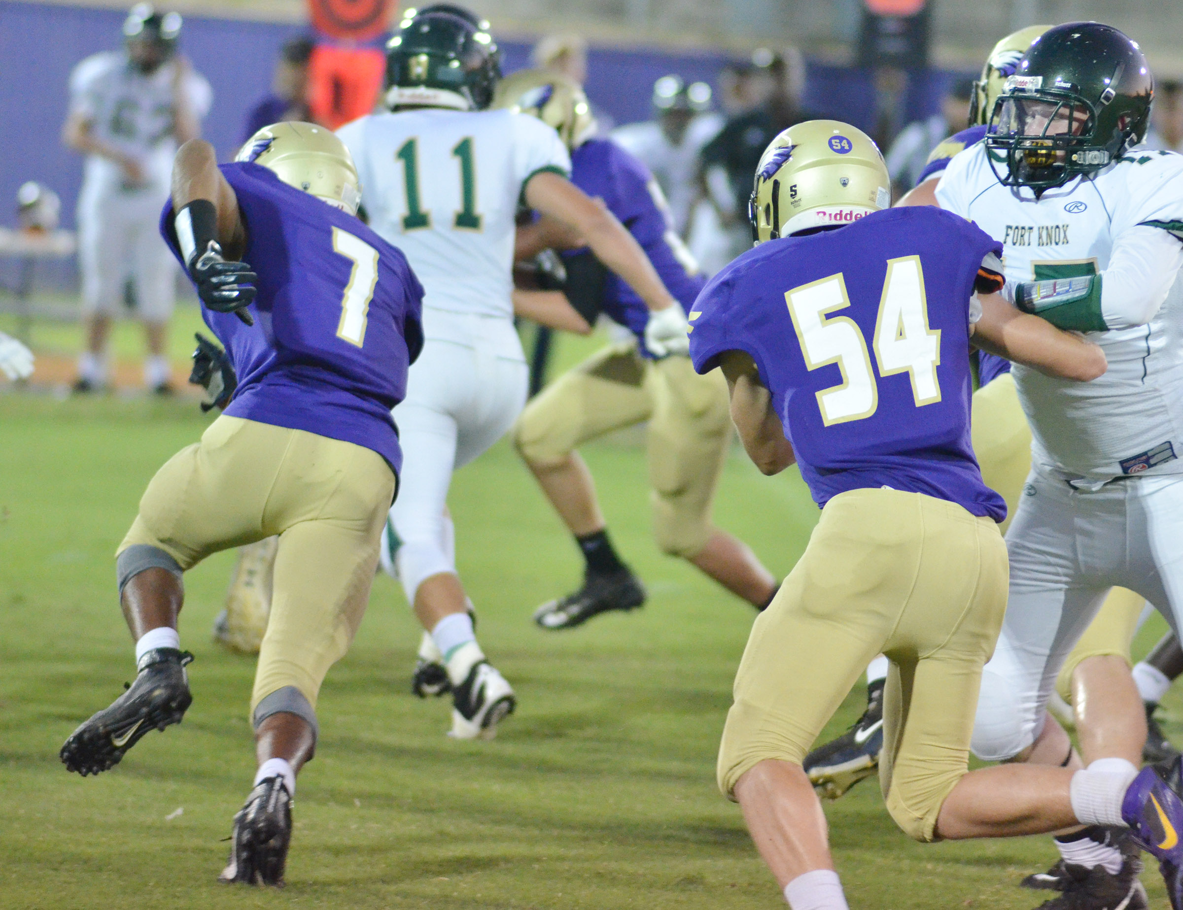 CHS senior Devonte Cubit, at left, and sophomore Devon Reardon tackle.