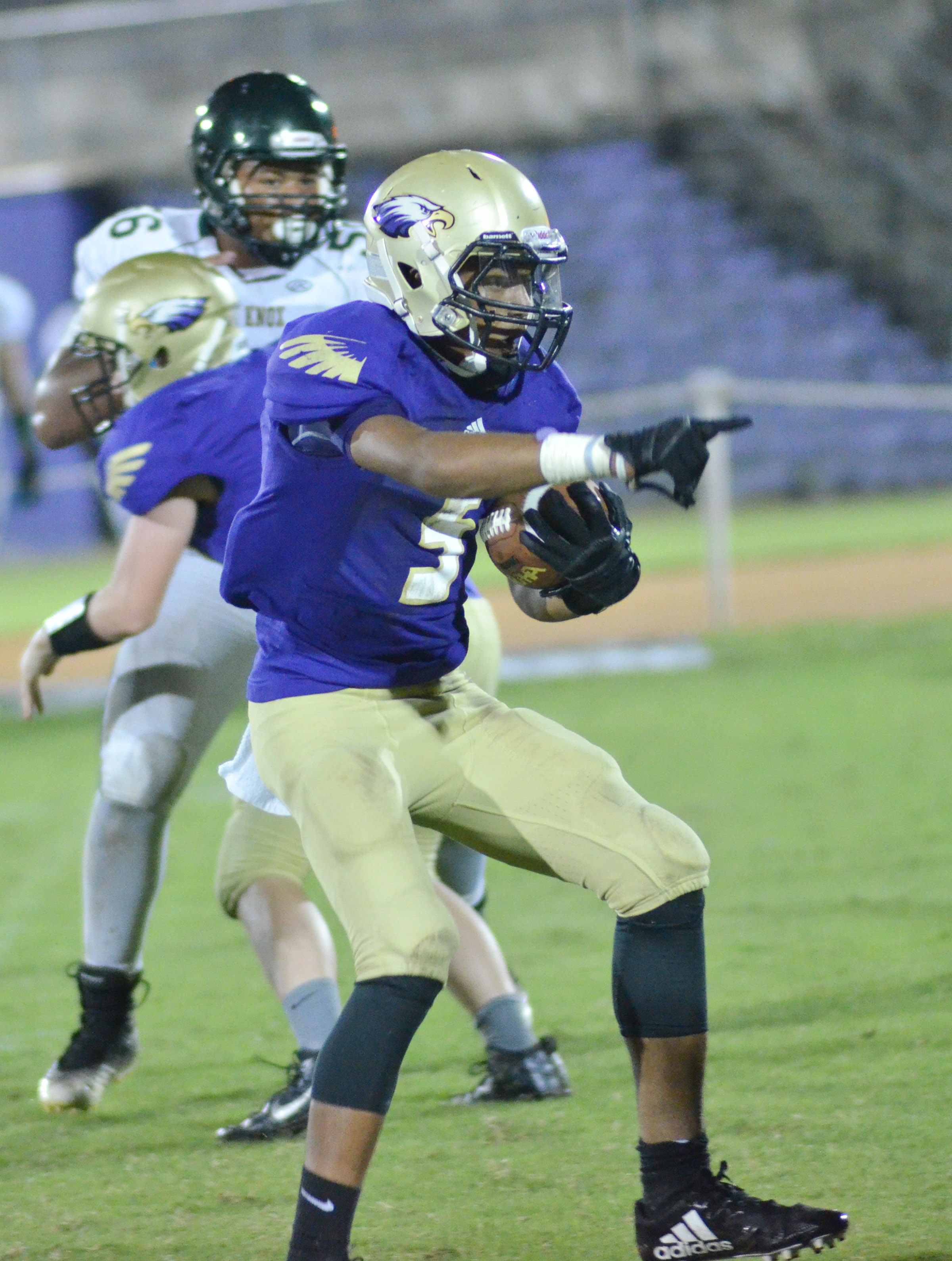 CHS freshman Reggie Thomas runs the ball.