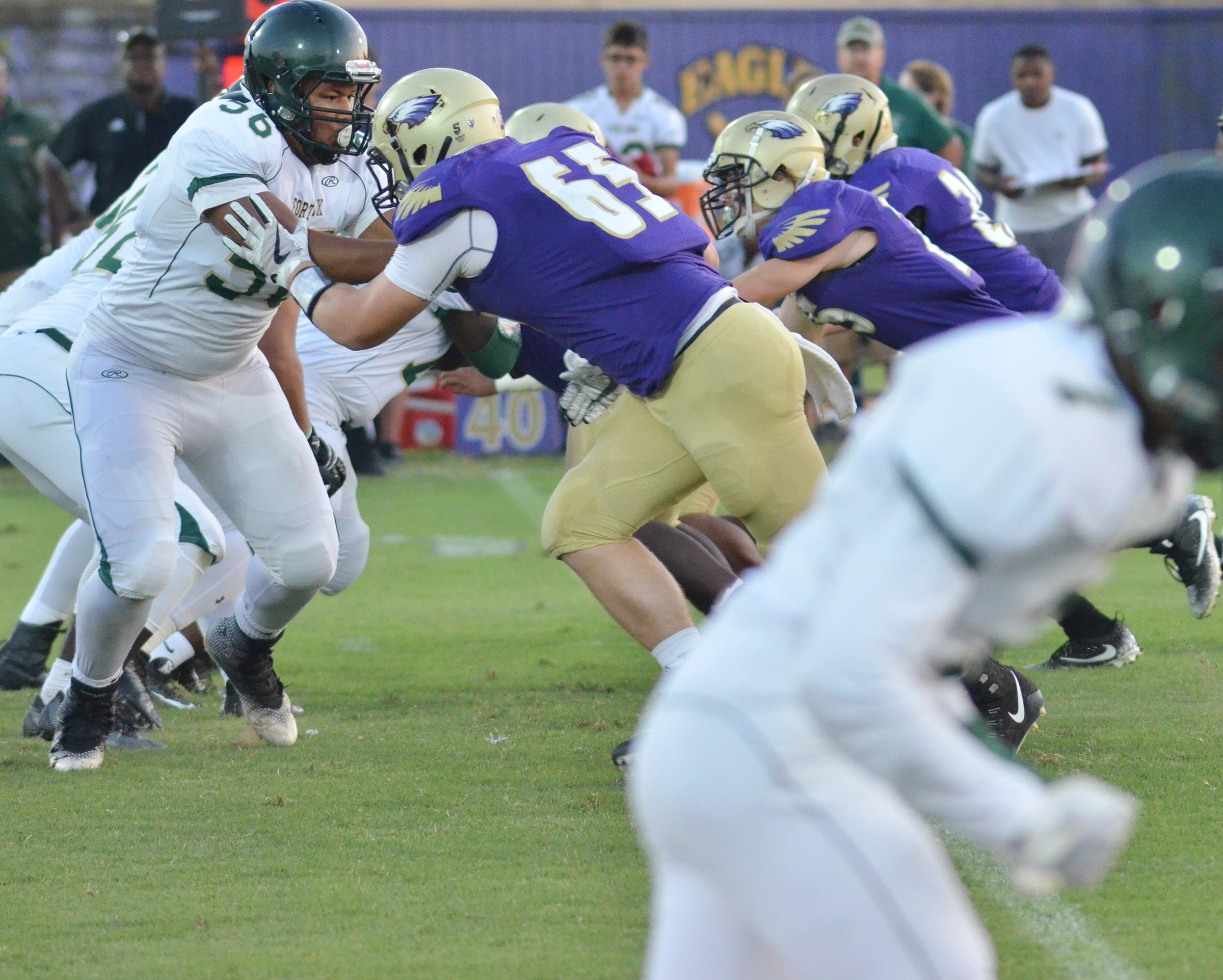 CHS junior Lane Bottoms leads his teammates as they tackle.