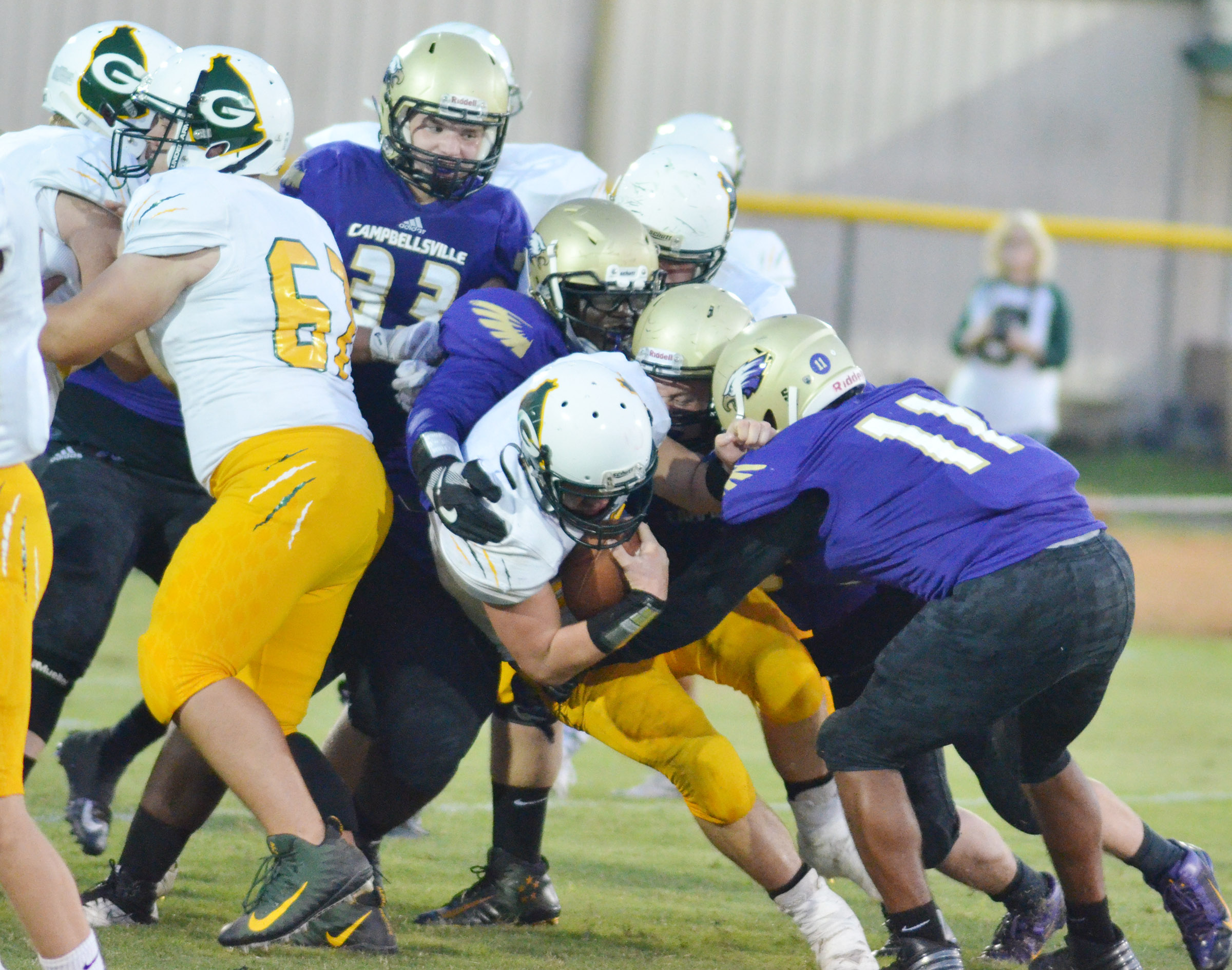CHS sophomore Braden Page, at right, leads his teammates as they tackle.