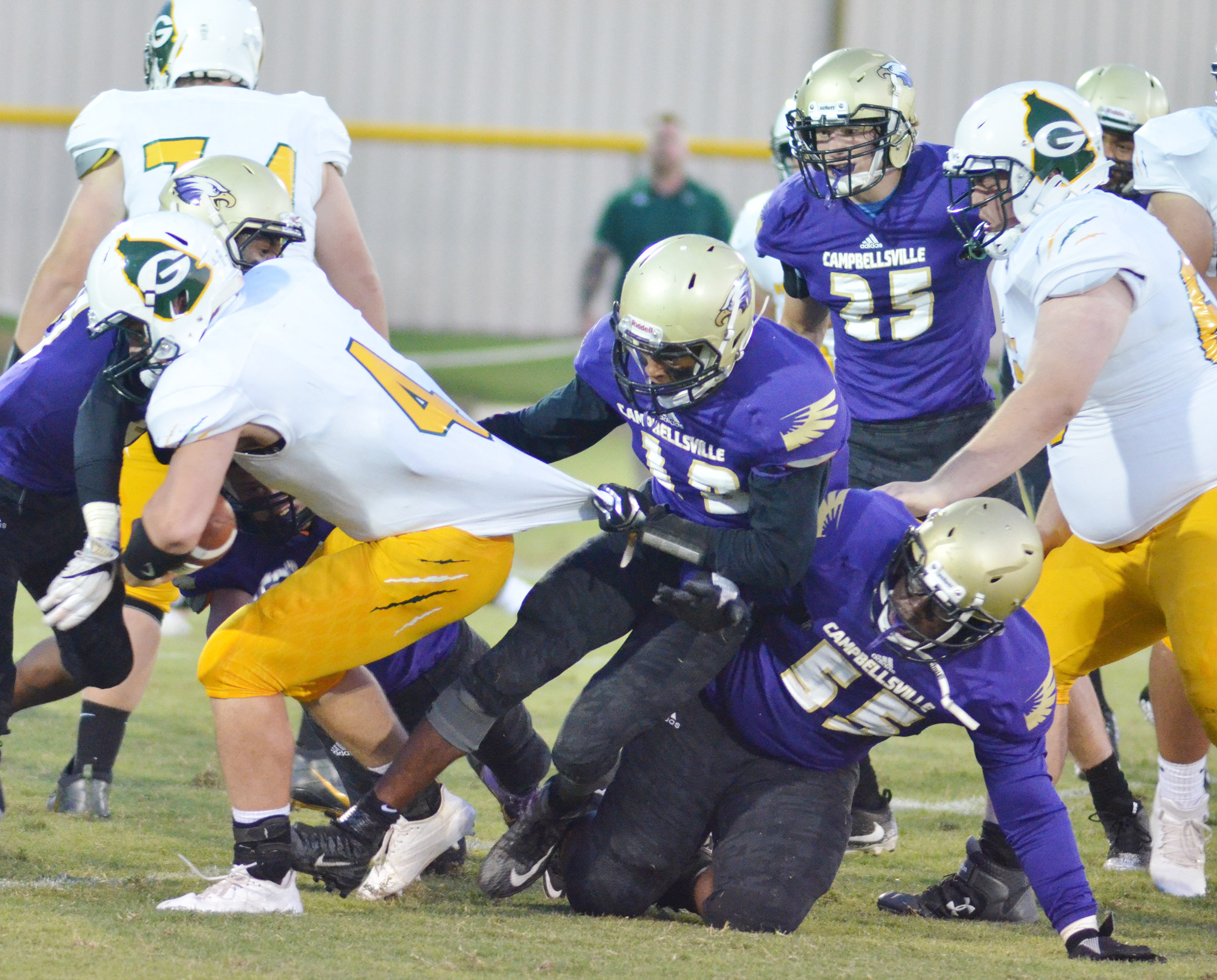 CHS senior Devonte Cubit pulls a Green County player to the ground.