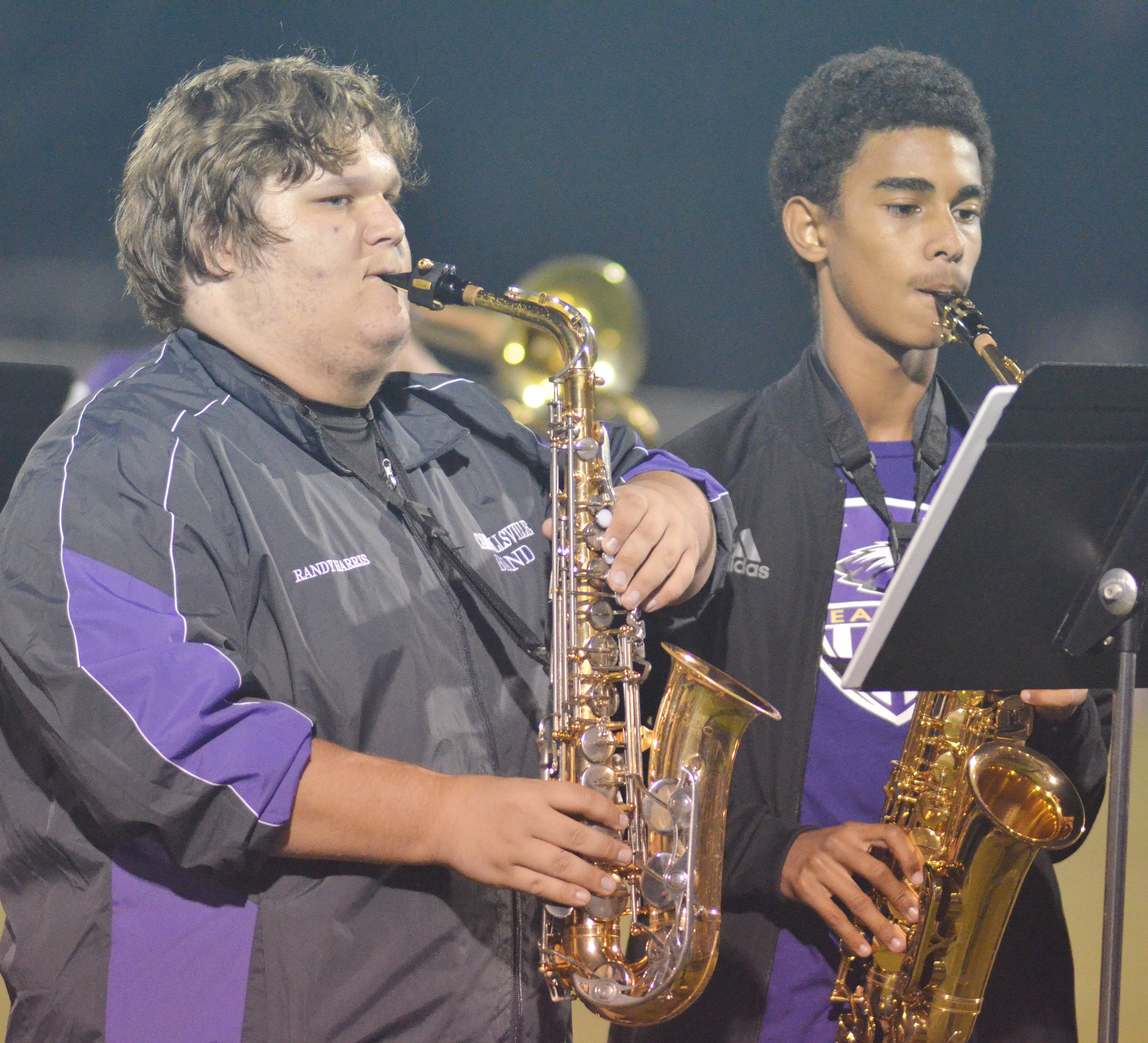 CHS junior Randy Harris, at left, and sophomore David Silva play saxophone during halftime.