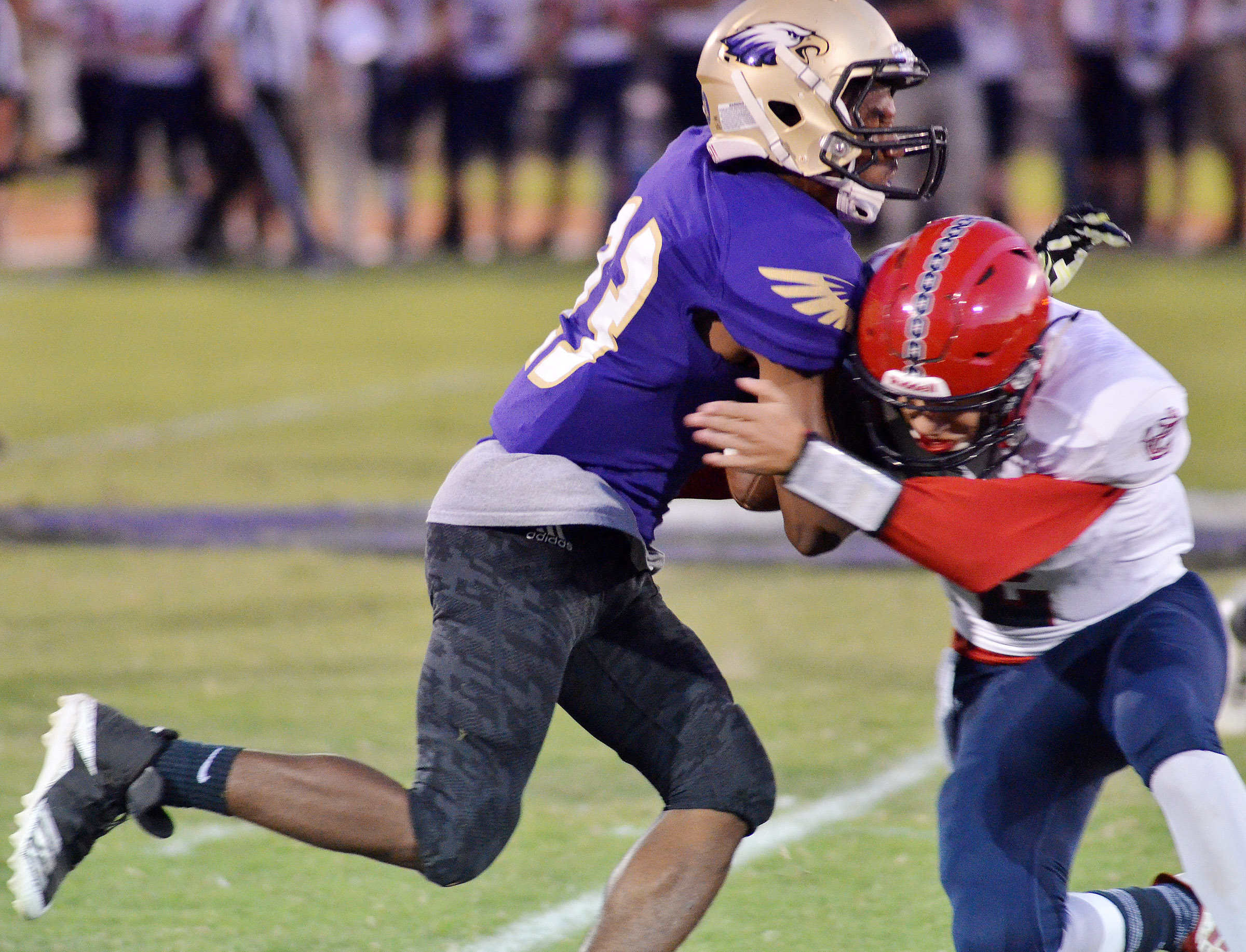 CHS senior Tyrion Taylor tackles.