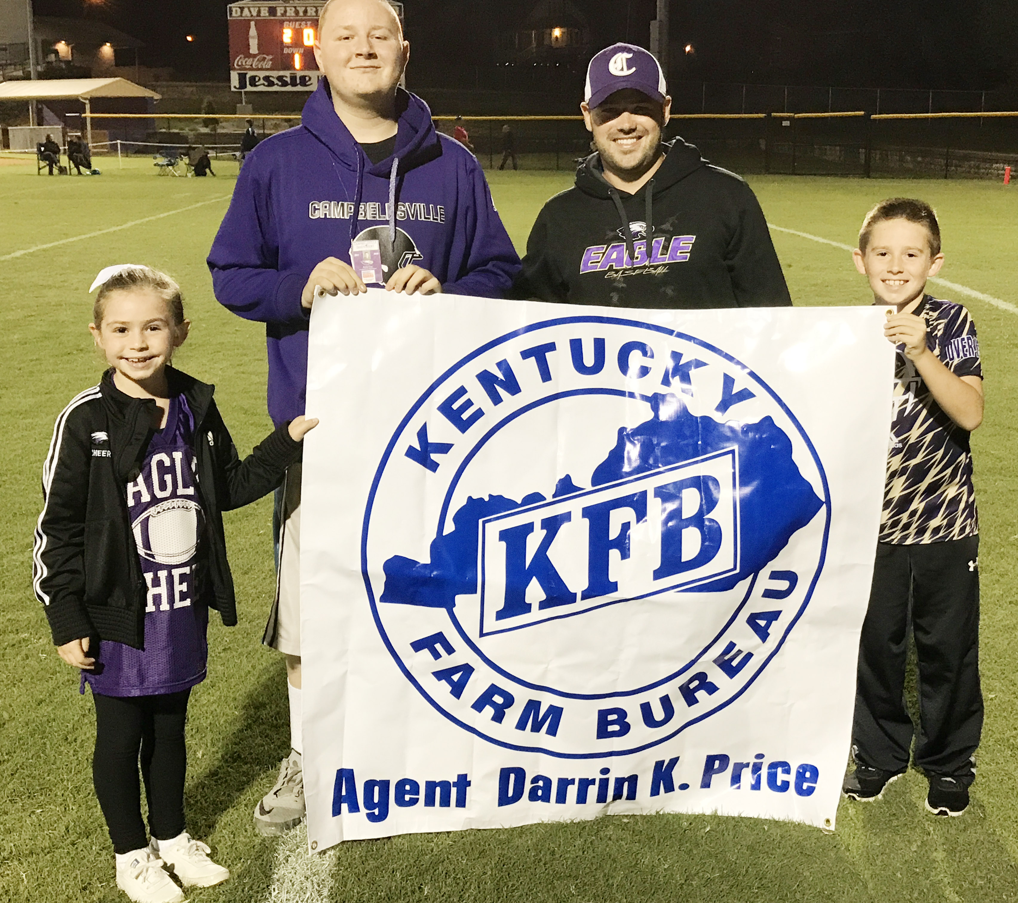 Kentucky Farm Bureau sponsors the Kick for Kids, which awards $50 for a successful field goal attempt during halftime. From left are Campbellsville Elementary School second-grader Lainey Price, CHS freshman Kylar Cox, who received $50 for head baseball coach Blake Milby's successful kick, Milby and third-grader Lanigan Price.