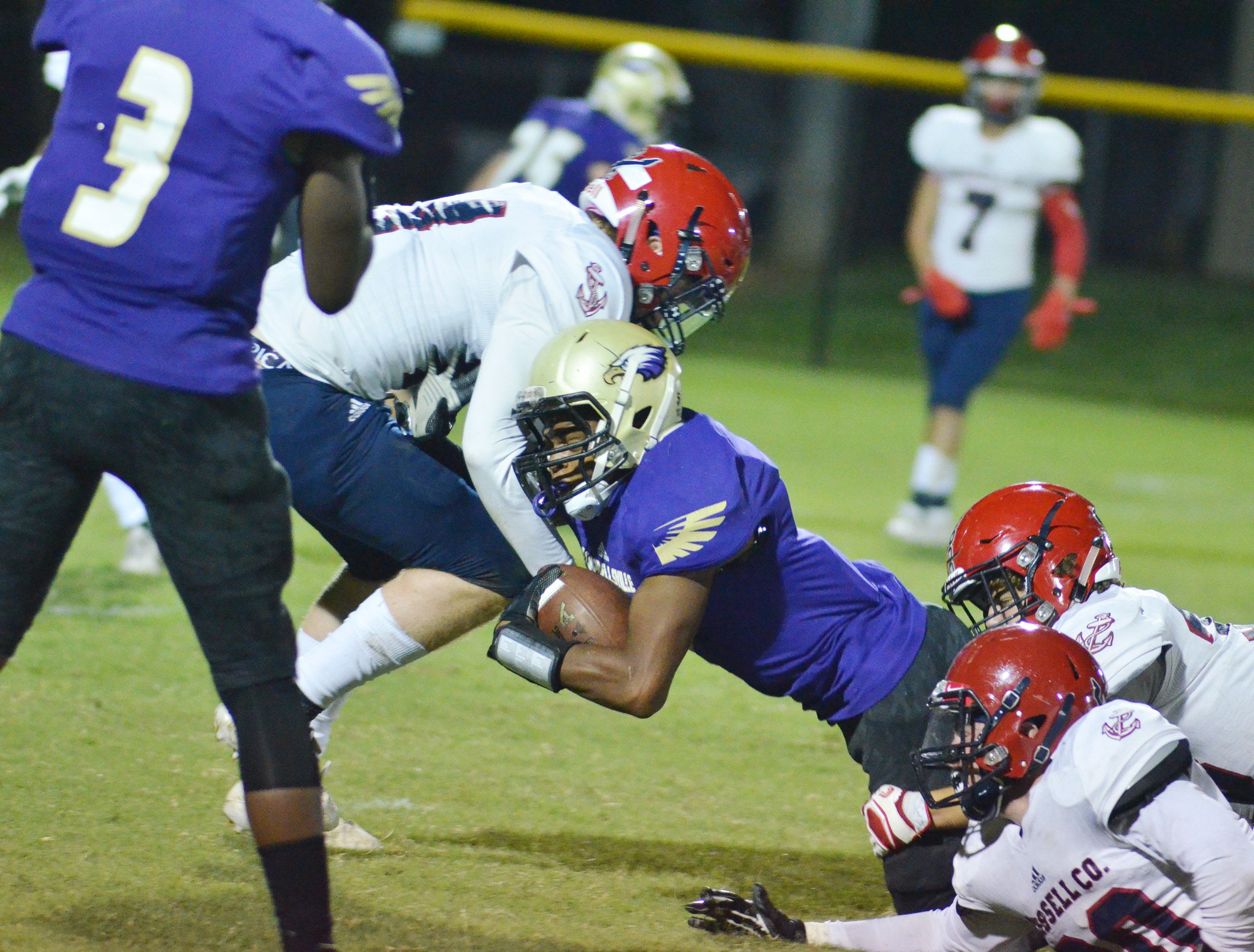 CHS senior Devonte Cubit is tackled.