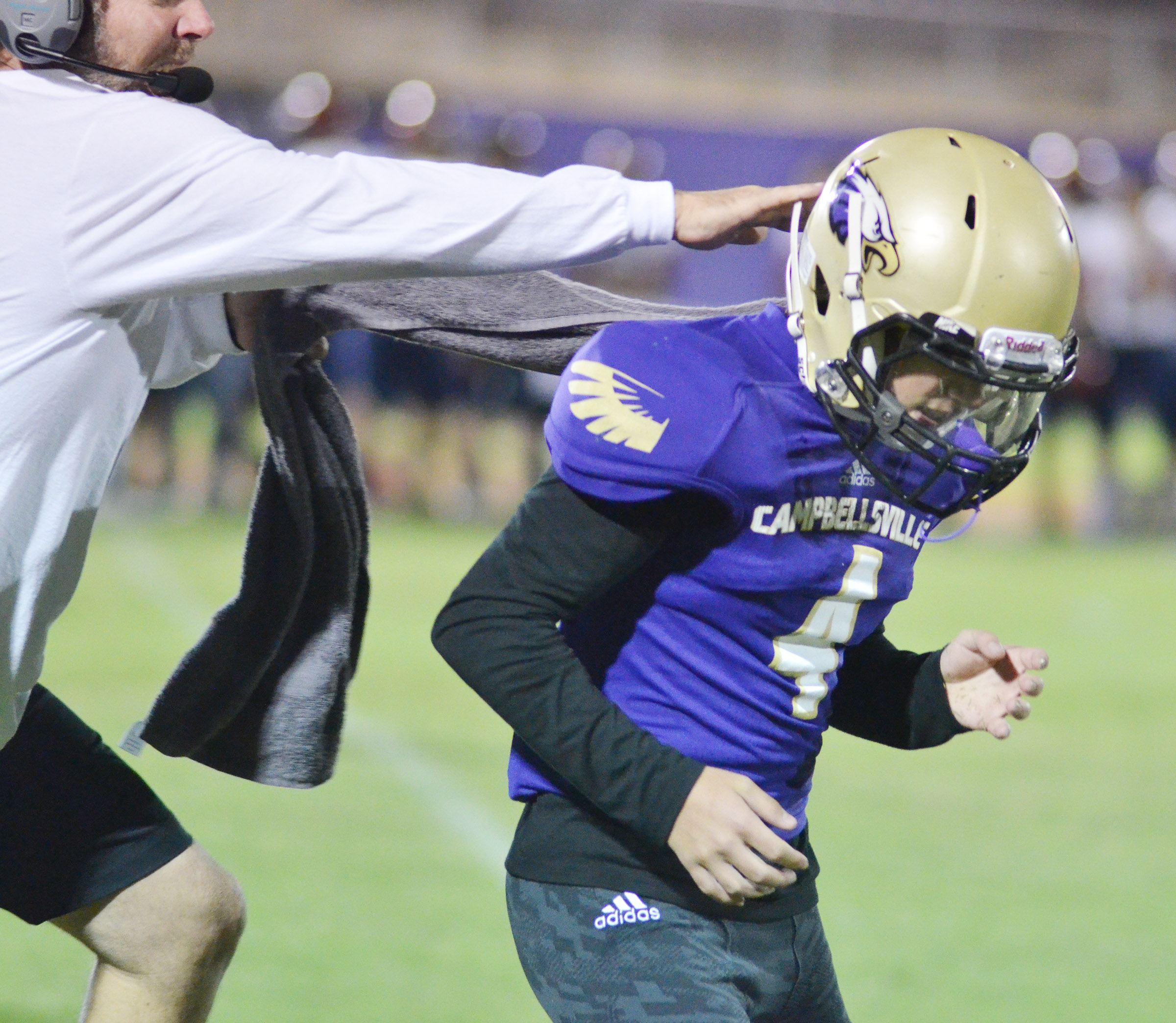 CHS assistant football coach Herb Wiseman celebrates a tackle with senior Austin Carter.