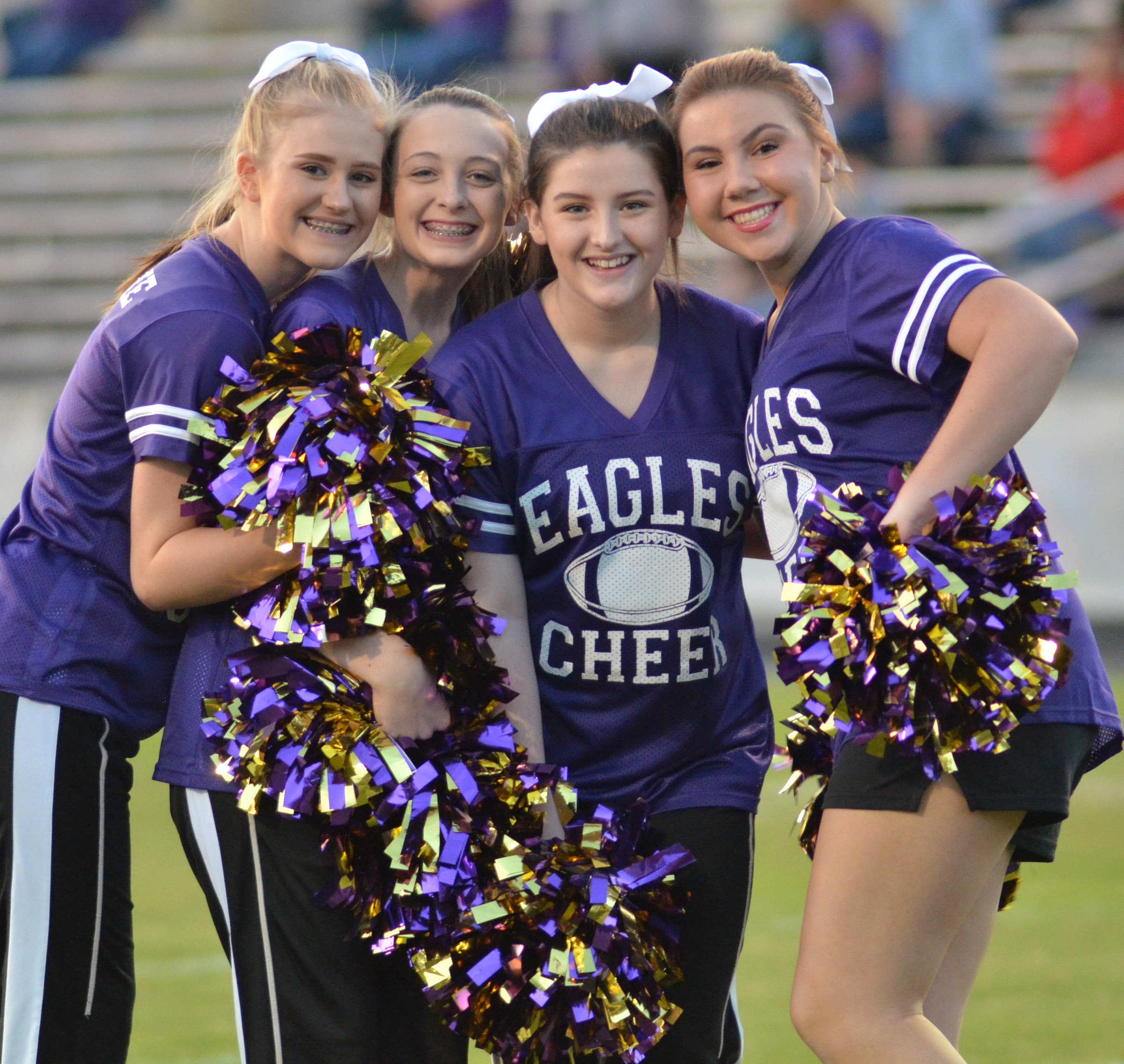 CHS cheerleaders, from left, sophomore Isabella Osborne, junior Caleigh Bright and sophomores Alli Wilson and Lauryn Agathen get set to run on the field with the football team.