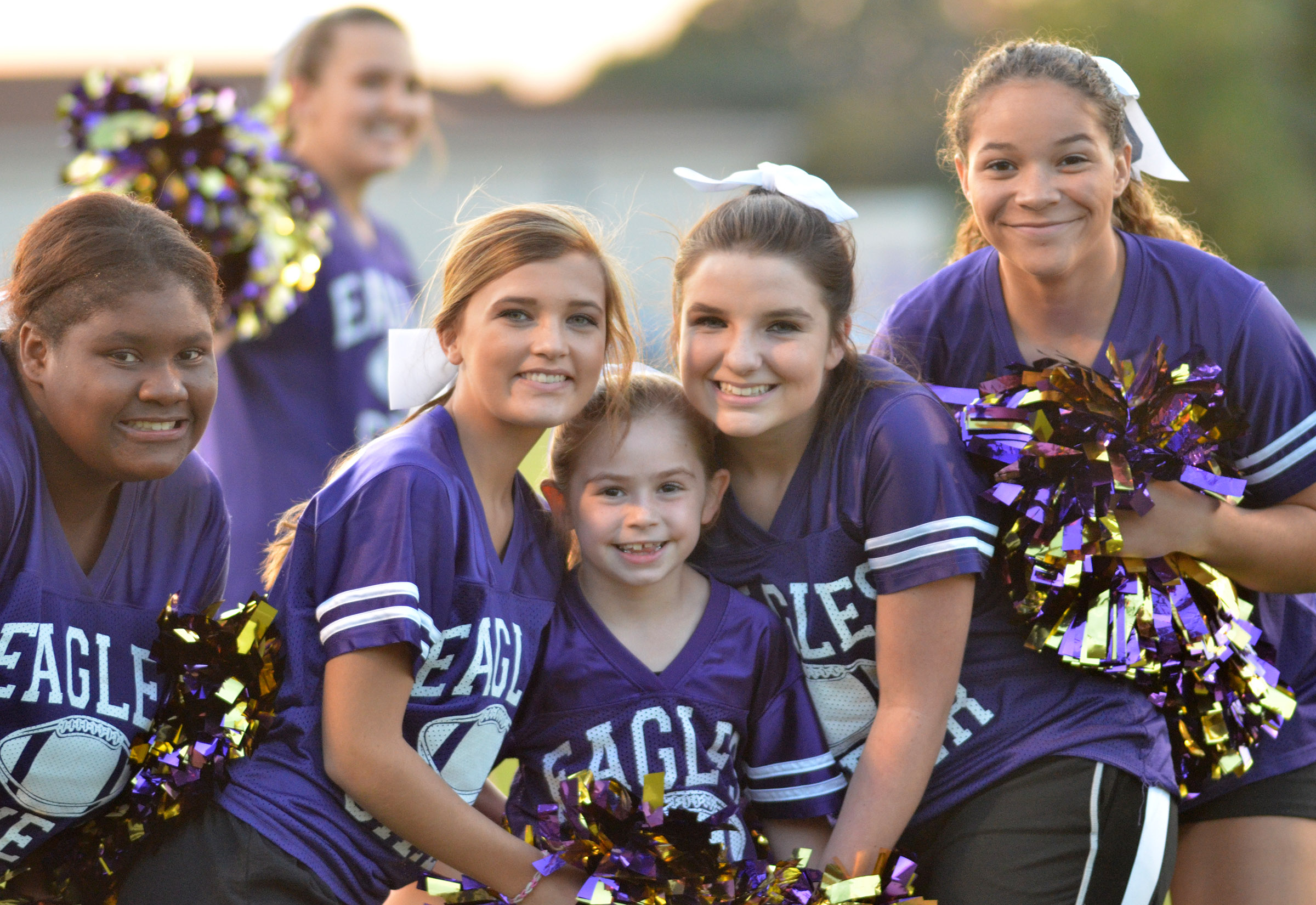 CHS cheerleaders, from left, sophomore Jakyia Mitchell, freshman Carly Adams, Campbellsville Elementary School second-grader Lainey Price and sophomores Sydney Wilson and Taliyah Hazelwood get ready to run on the field with their football team. In back is sophomore Haley Morris.
