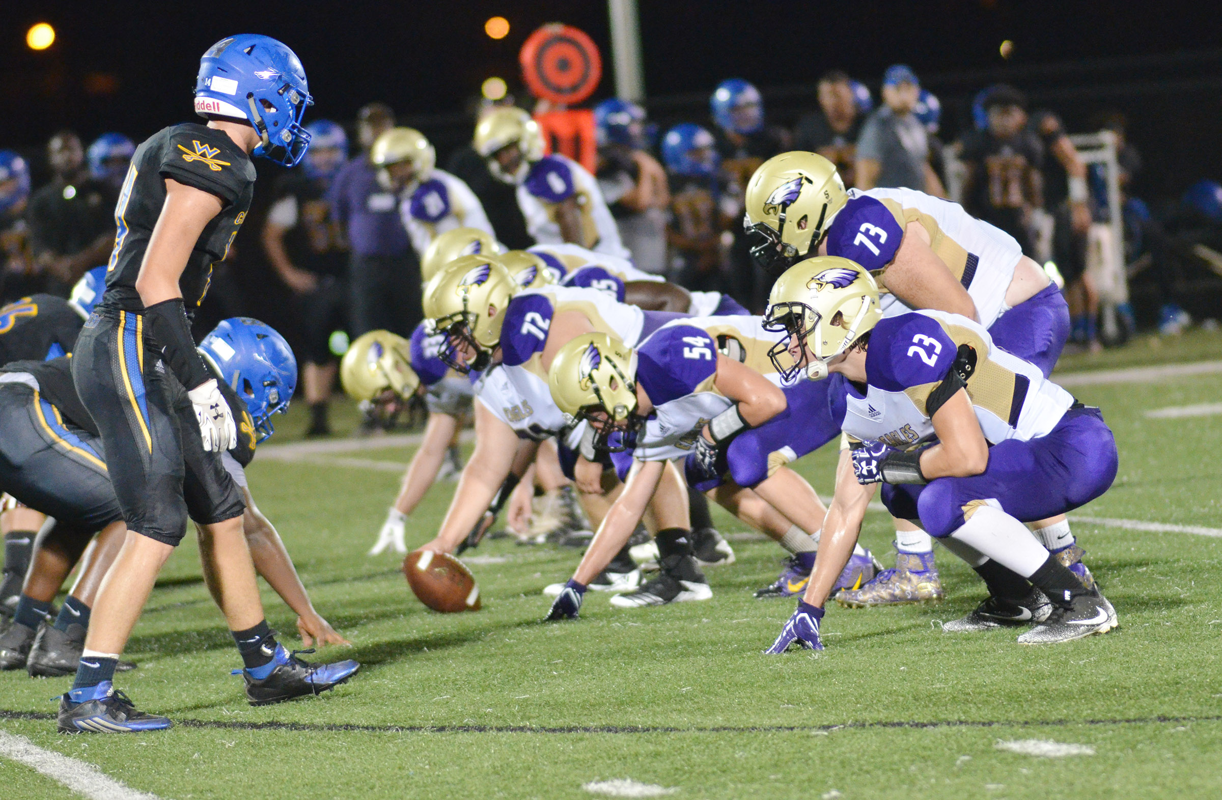 CHS offensive line players get ready to snap the ball.