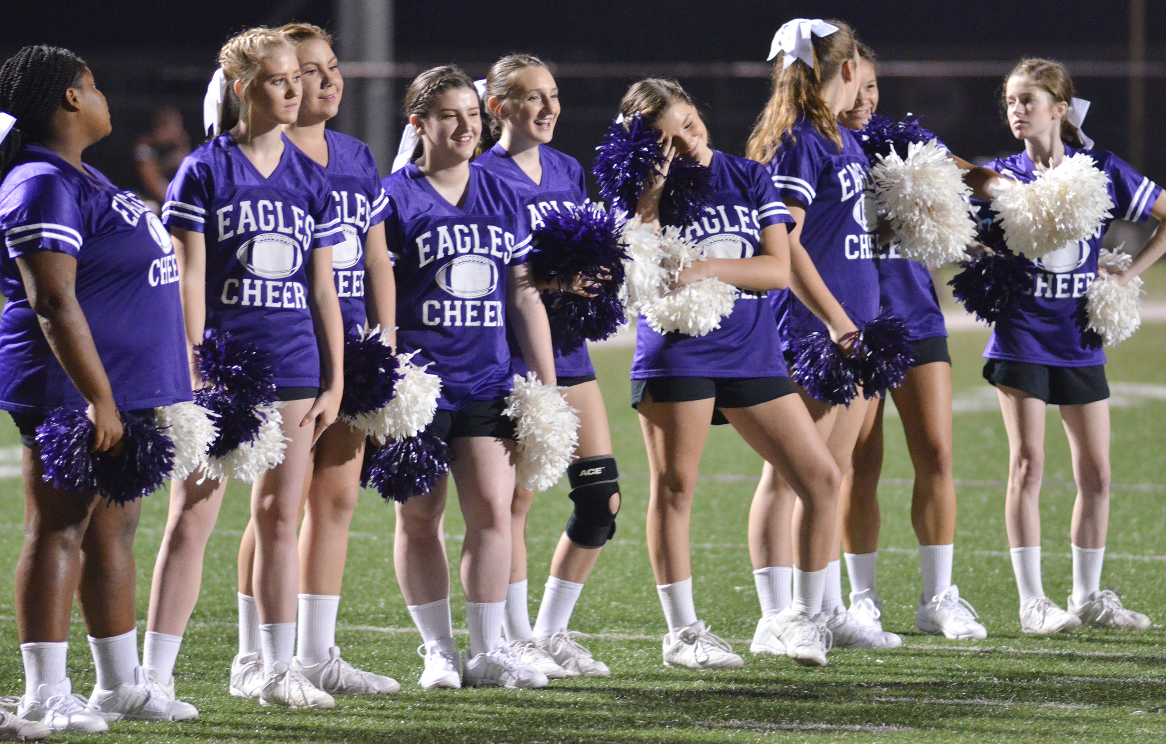 CHS cheerleaders watch as Campbellsville Independent Schools Superintendent Kirby Smith attempts to kick a field goal.