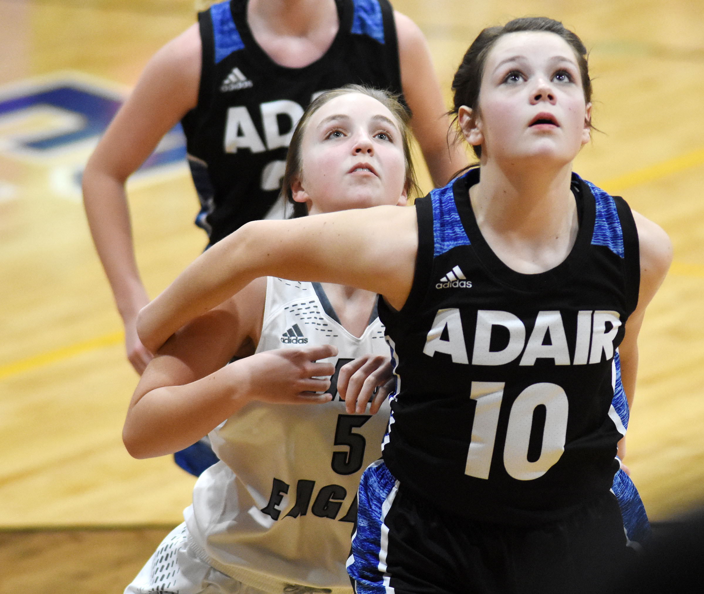 Campbellsville Middle School eighth-grader Lainey Watson battles for the rebound.