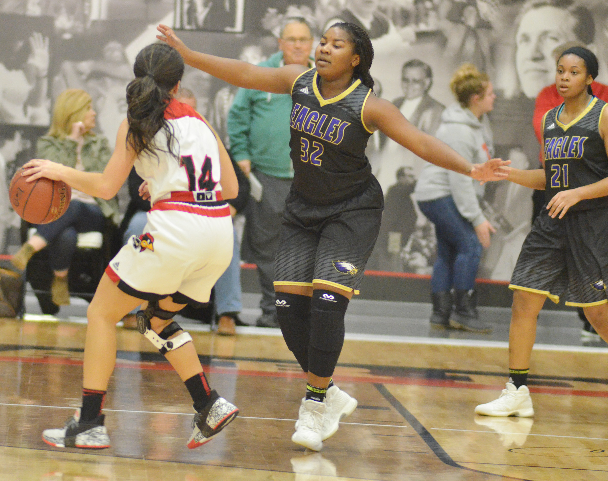 CHS senior Kiyah Barnett, center, and Vonnea Smith play defense.