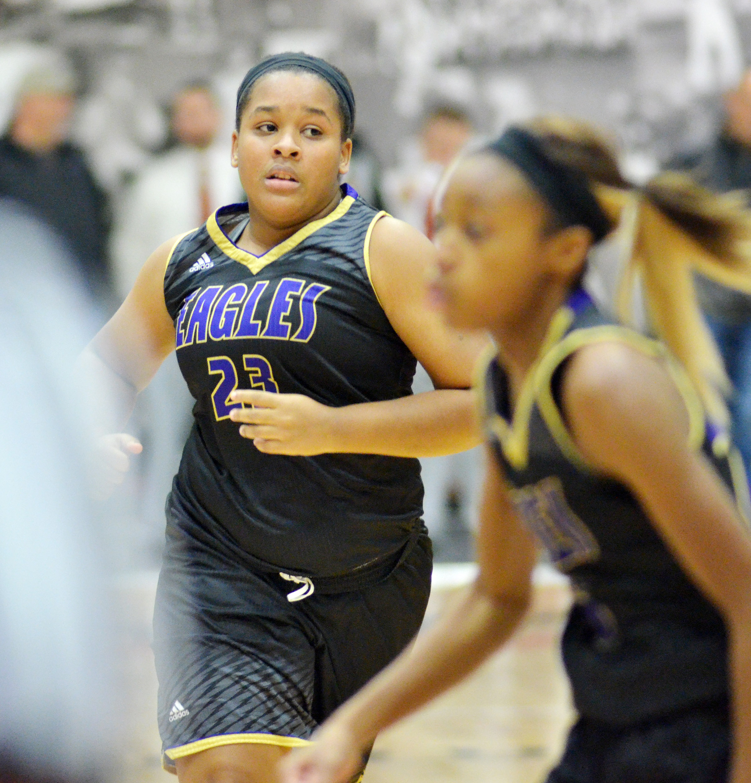 CHS senior Kayla Young runs down the court.