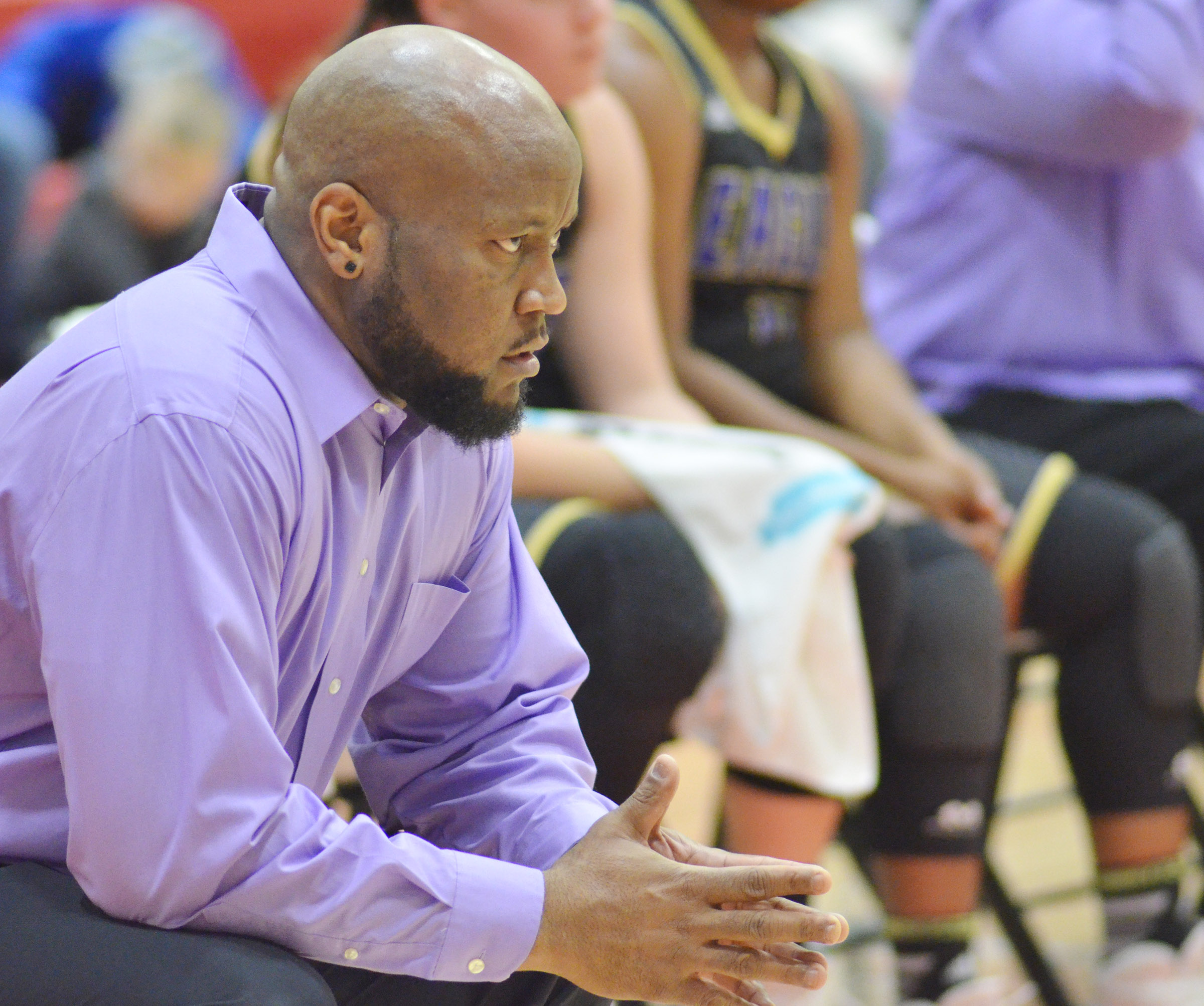 CHS girls' basketball head coach Anthony Epps watches as his players score.