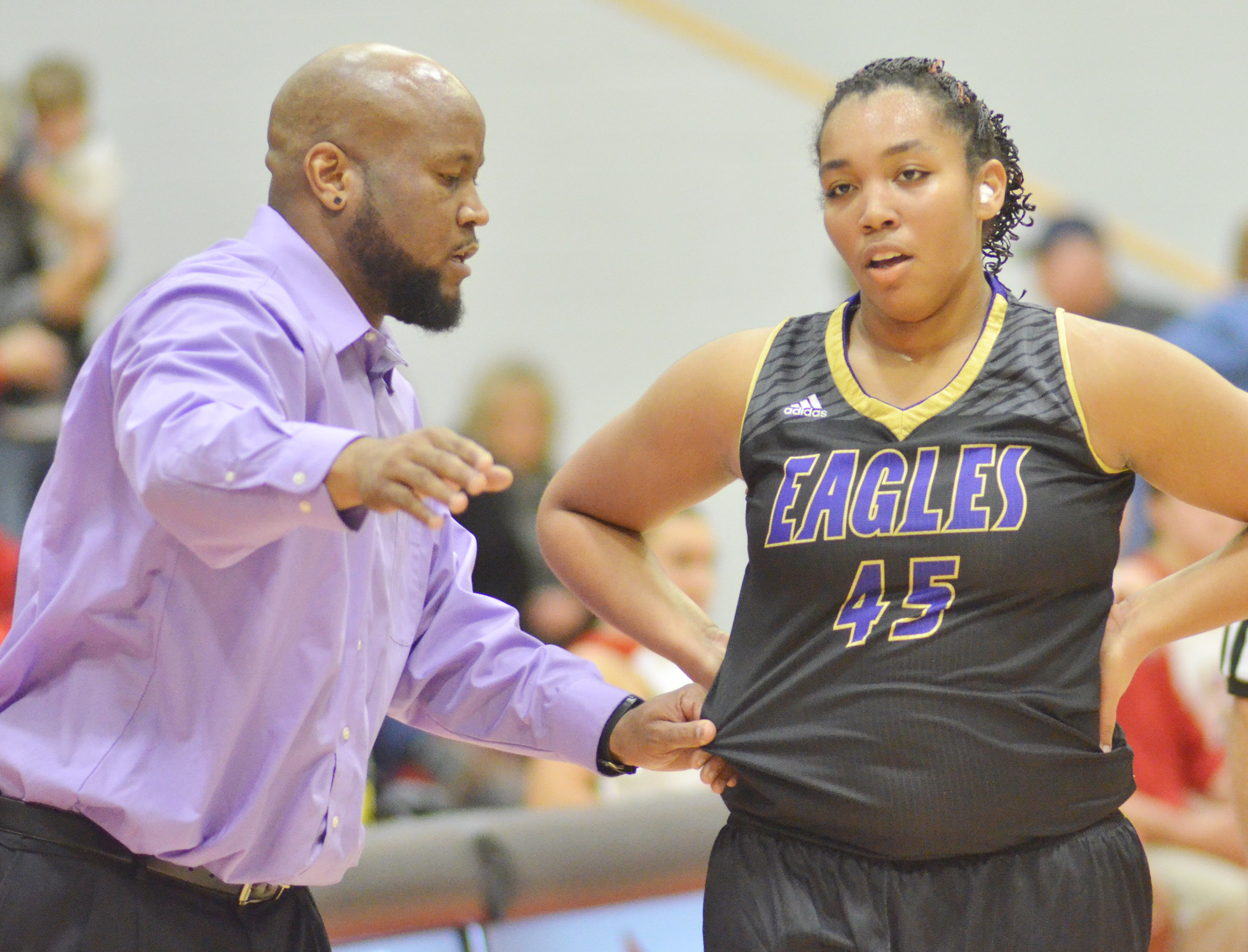 CHS girls' head basketball coach Anthony Epps talks to junior Malaya Hoskins.
