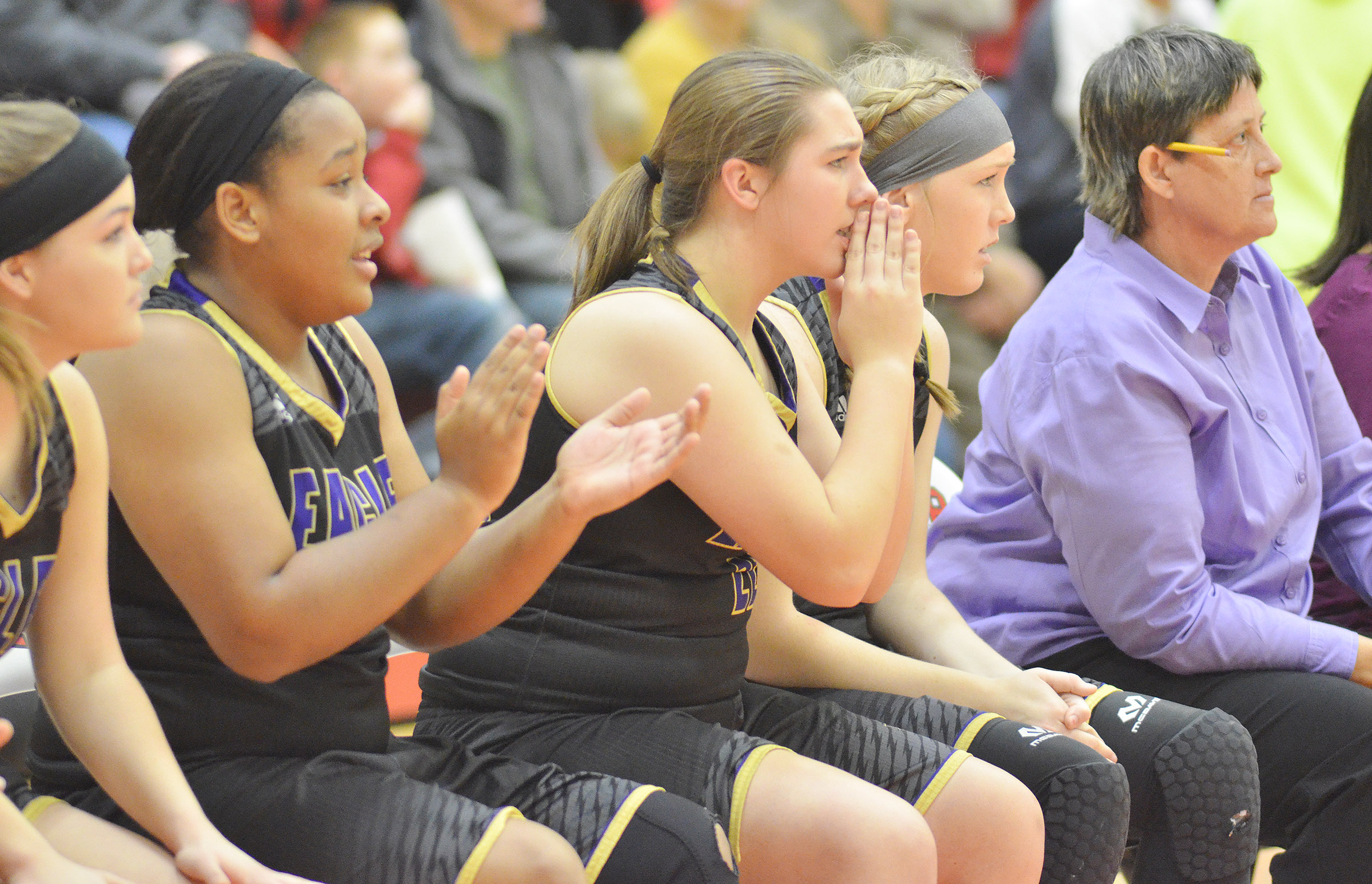 CHS freshman Abi Wiedewitsch, center, and her teammates watch as the Lady Eagles defeat Taylor County.
