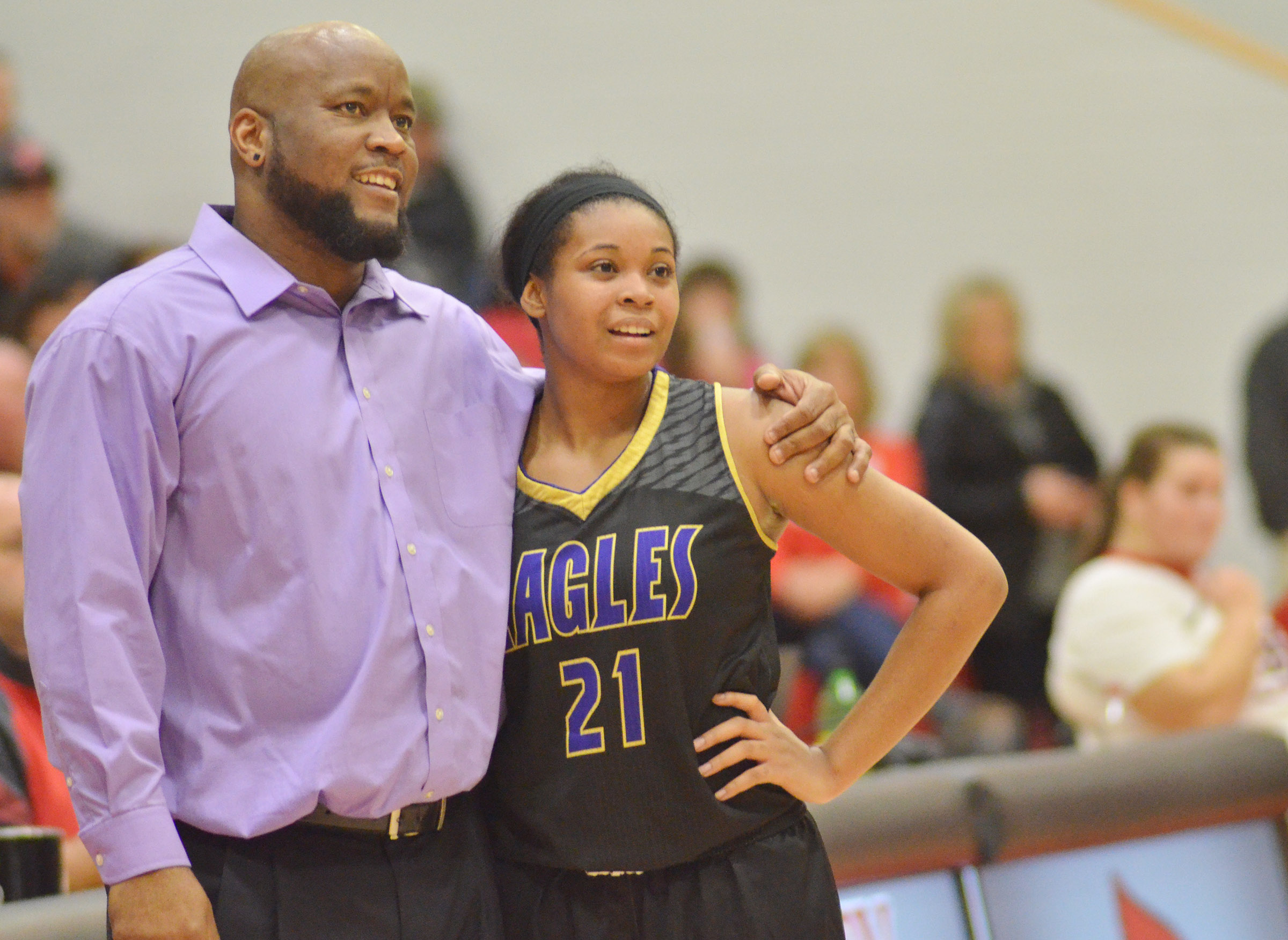 CHS girls' head basketball coach Anthony Epps and senior Vonnea Smith watch as the Lady Eagles defeat Taylor County.