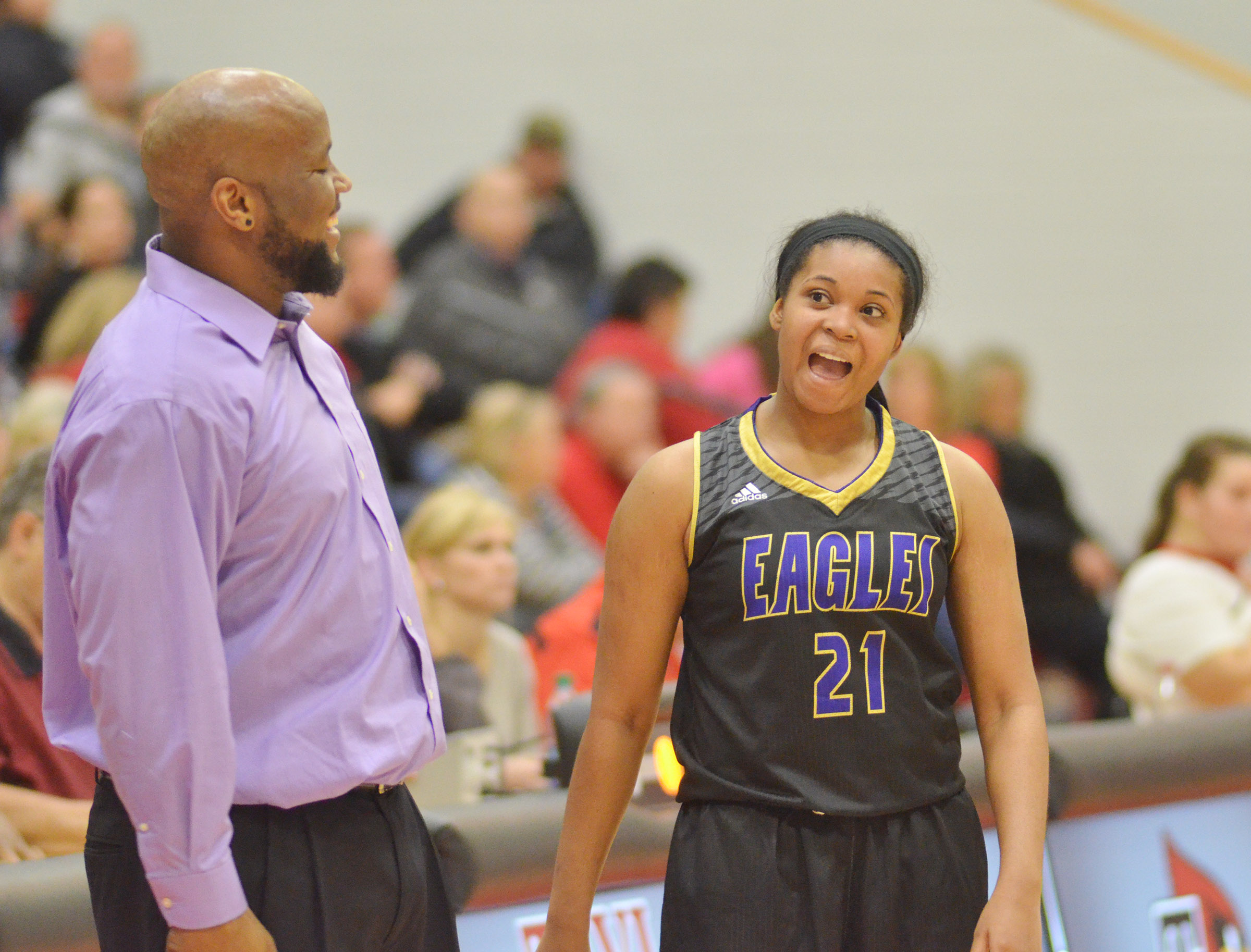 CHS girls' head basketball coach Anthony Epps and senior Vonnea Smith cheer as the Lady Eagles defeat Taylor County.