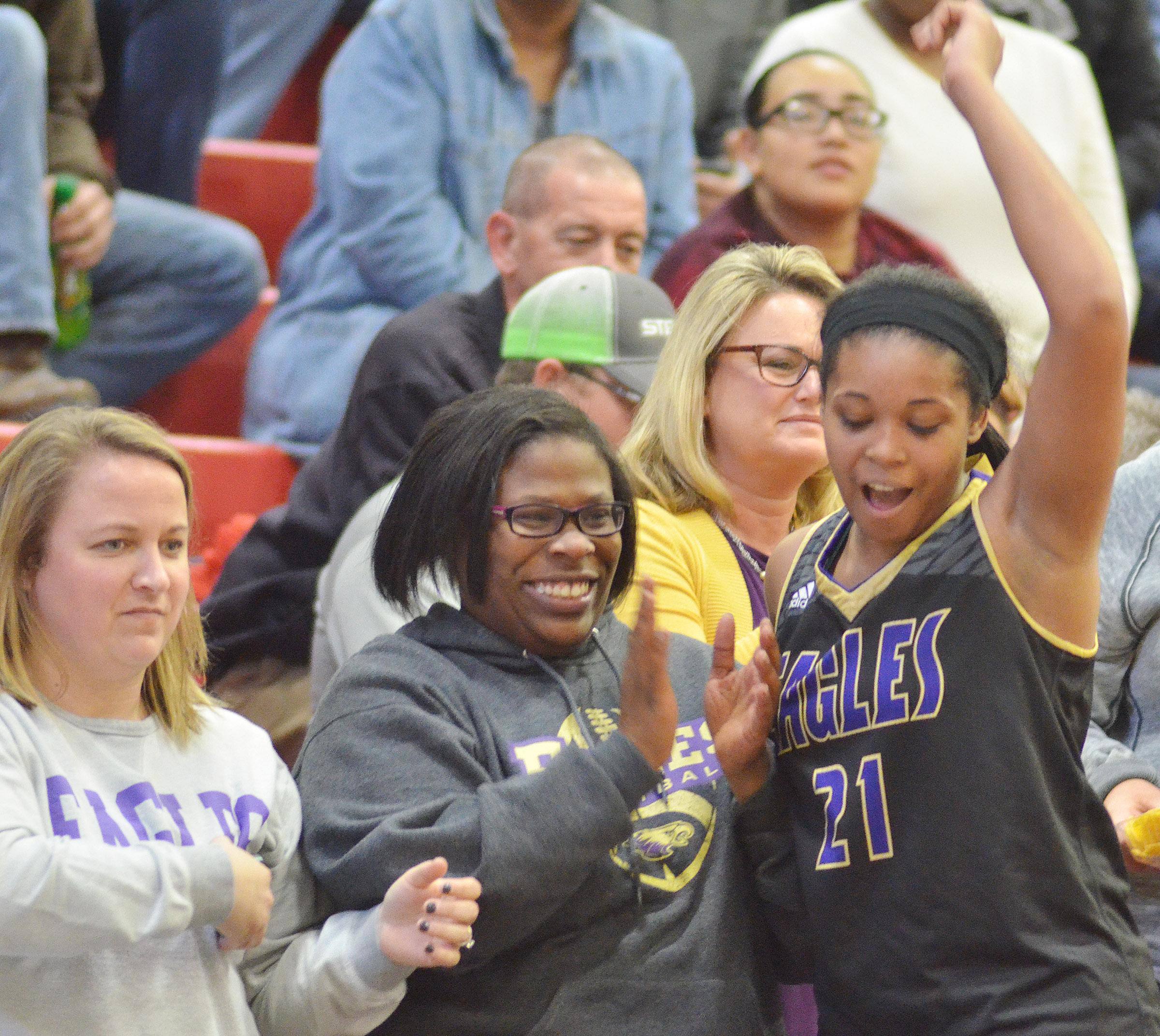 CHS senior Vonnea Smith cheers after the Lady Eagles defeat Taylor County with Campbellsville Middle School teachers Katie Campbell, at left, and Tiarra Cecil.