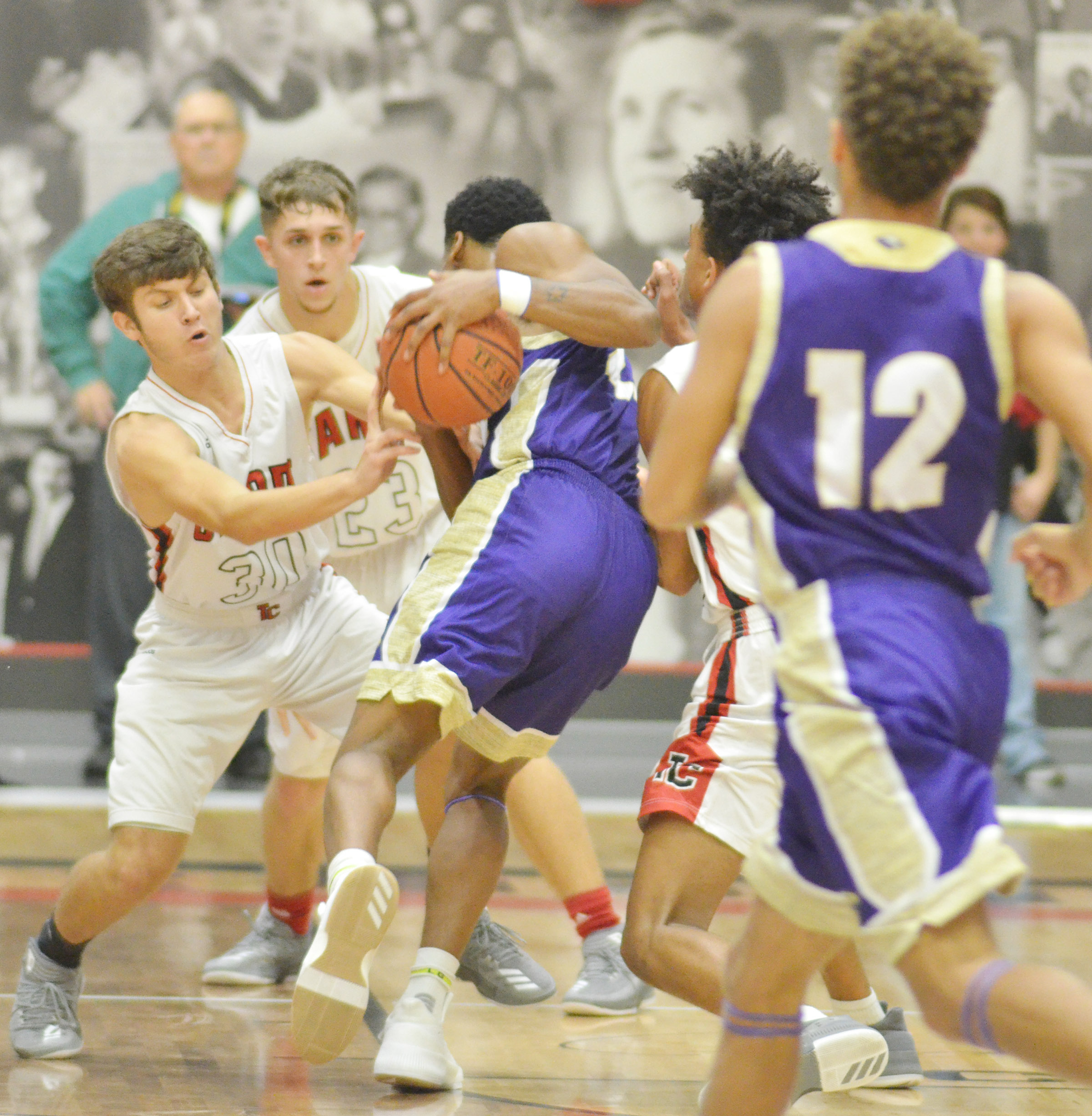 CHS junior Taj Sanders protects the ball.