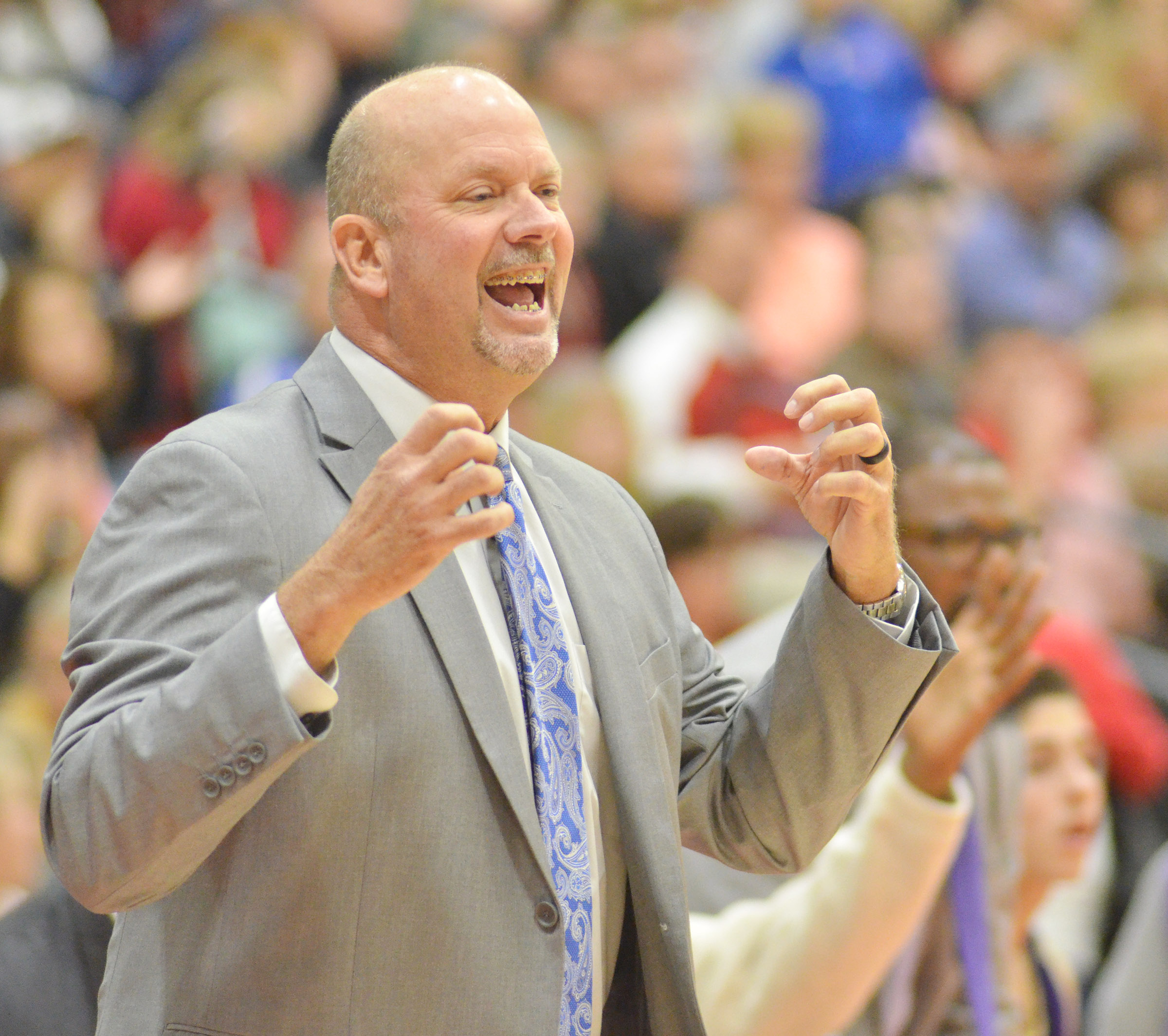 CHS boys' basketball head coach Tim Davis yells to his players.